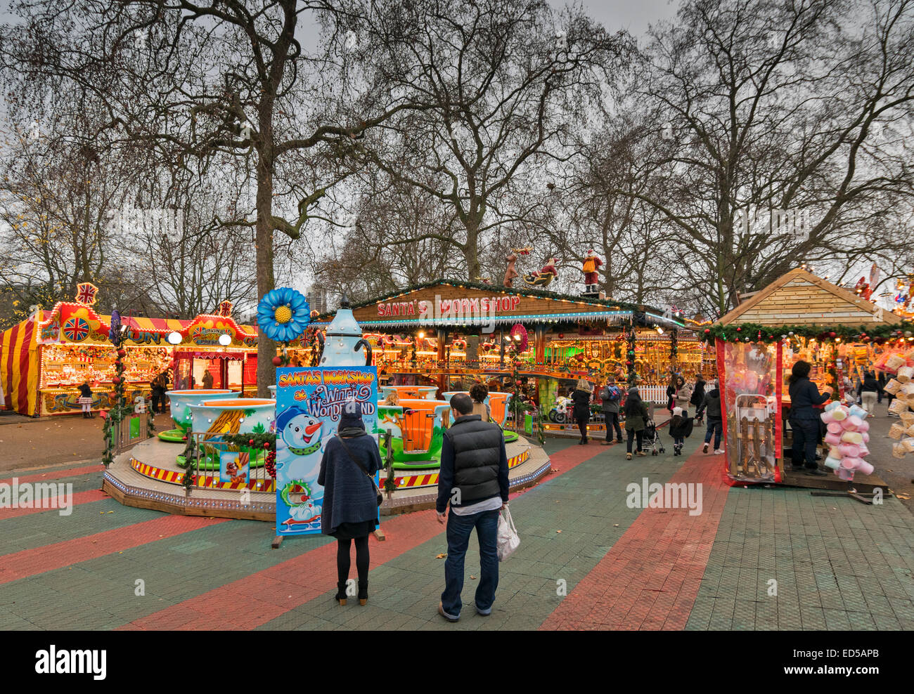 LONDON WINTER WONDERLAND IN HYDE PARK A LANE WITH SANTAS WORKSHOP AND AMUSEMENTS - Stock Image