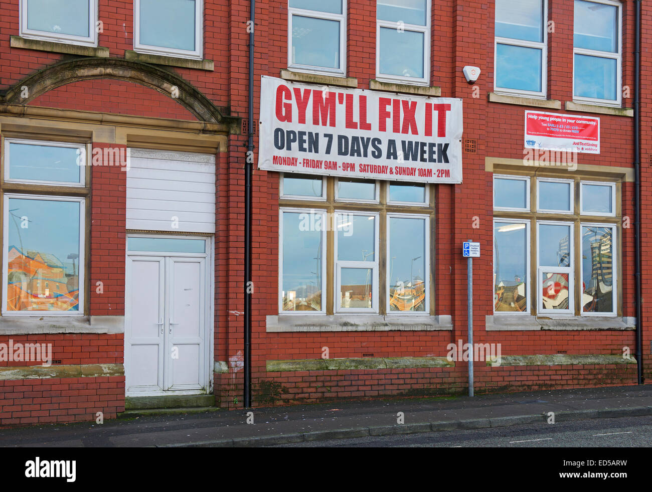 Gym building with sign - Gym'll Fix It - in Rochdale, Lancashire, England UK - Stock Image
