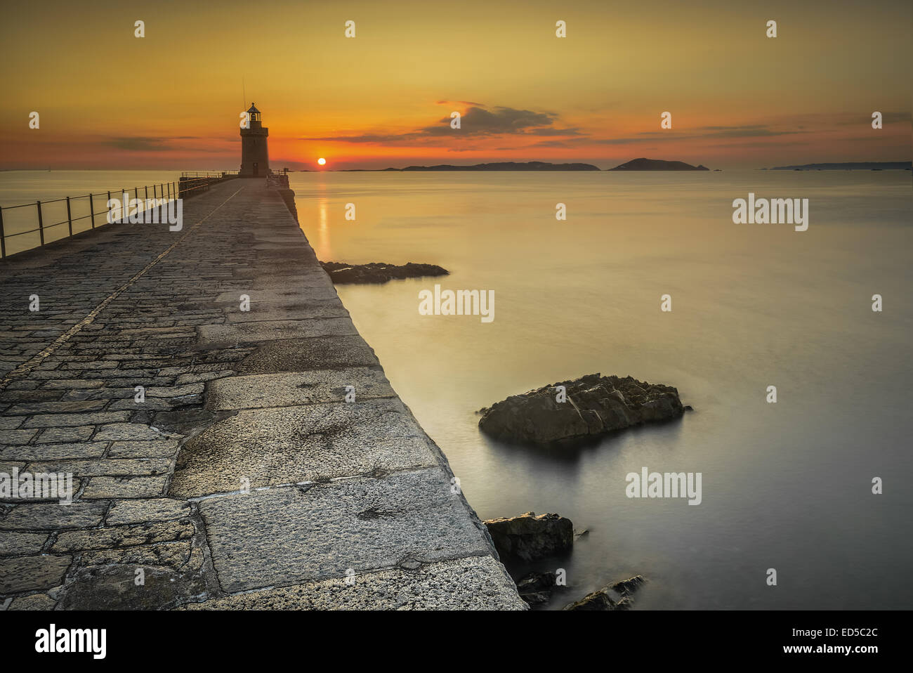 The sunrises over Herm, taken from castle cornet break water, St Peter Port, Guernsey Channel Islands - Stock Image