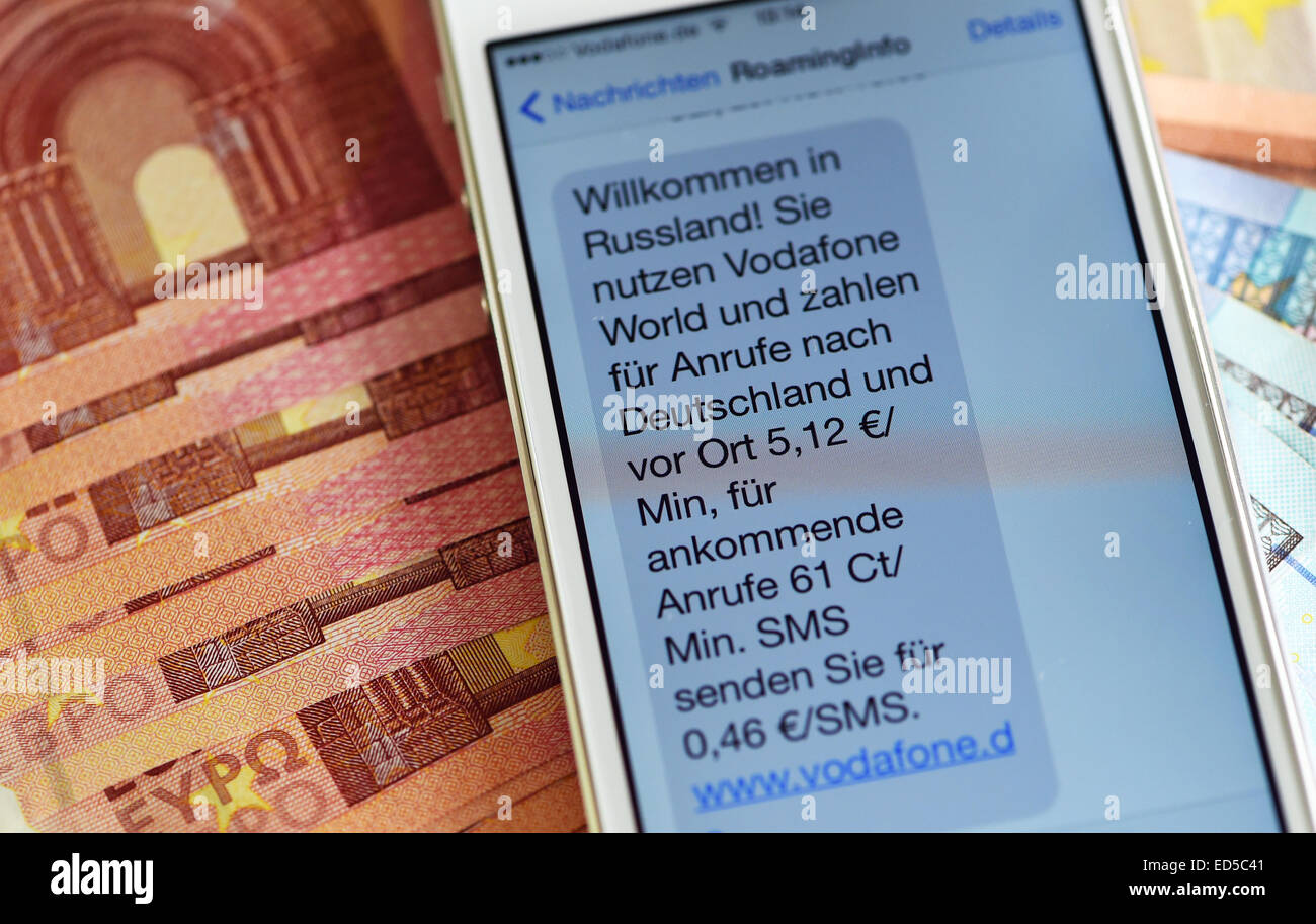 An SMS with information on roaming costs in Russia reads 'Welcome to Russia, you are using Vodafone world. Local - Stock Image