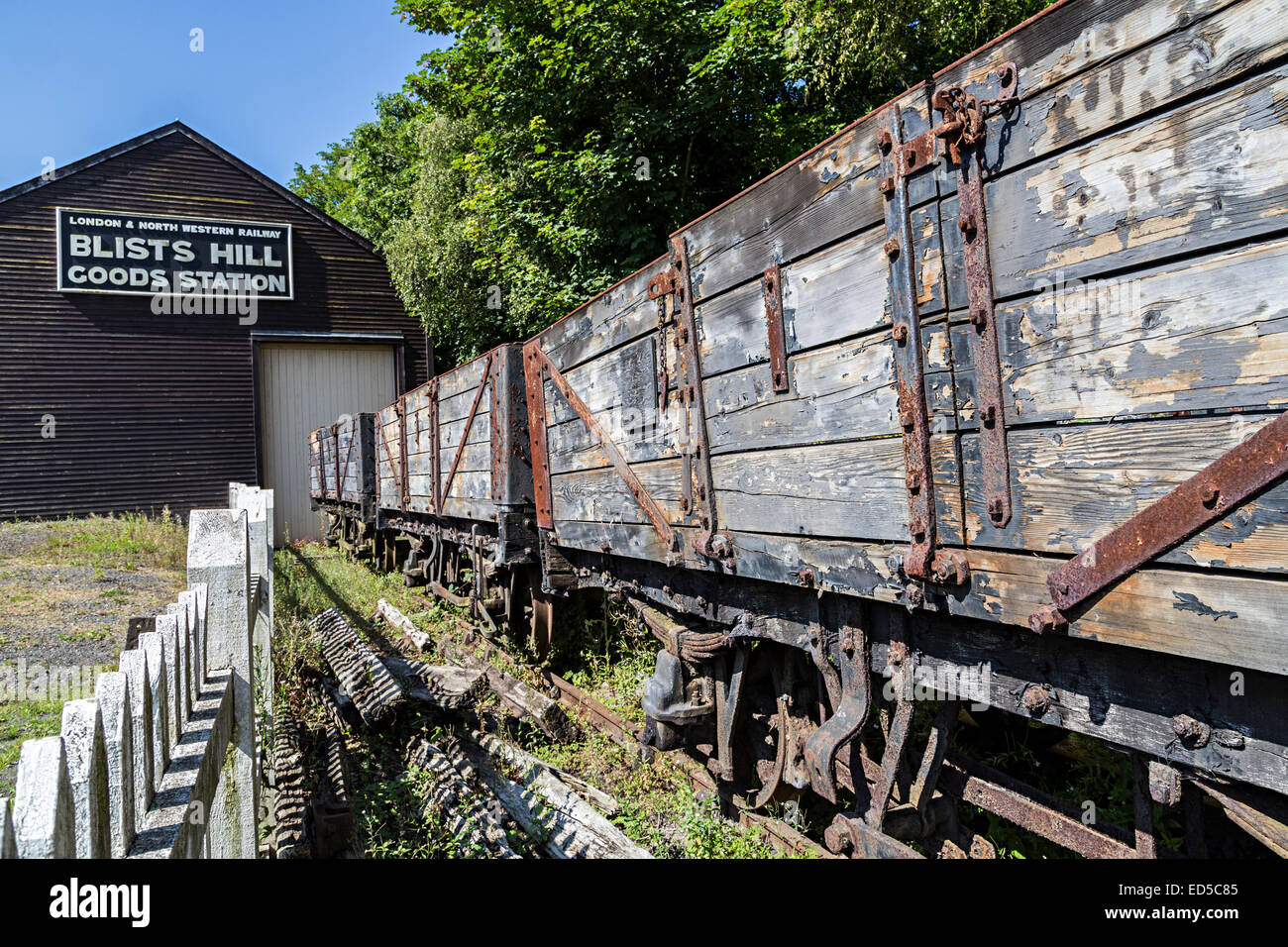 Rusting rolling stock wagons in railway siding, Blists Hill Victorian town, Ironbridge, Shropshire, England, UK - Stock Image