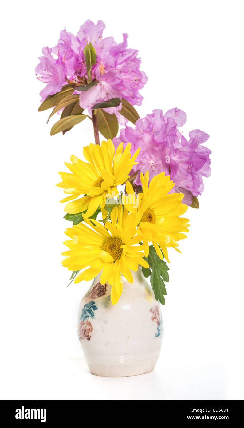 A spring bouquet of yellow mums and lavender PJM rhodoendrons in a ceramic vase. - Stock Image