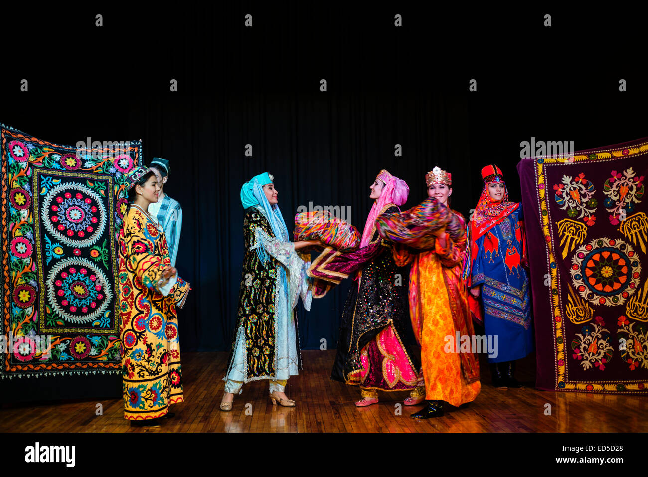 "Actors in traditional Uzbek costume of 19 century perform wedding ceremony during ""Instants of Eternity"" show in Stock Photo"