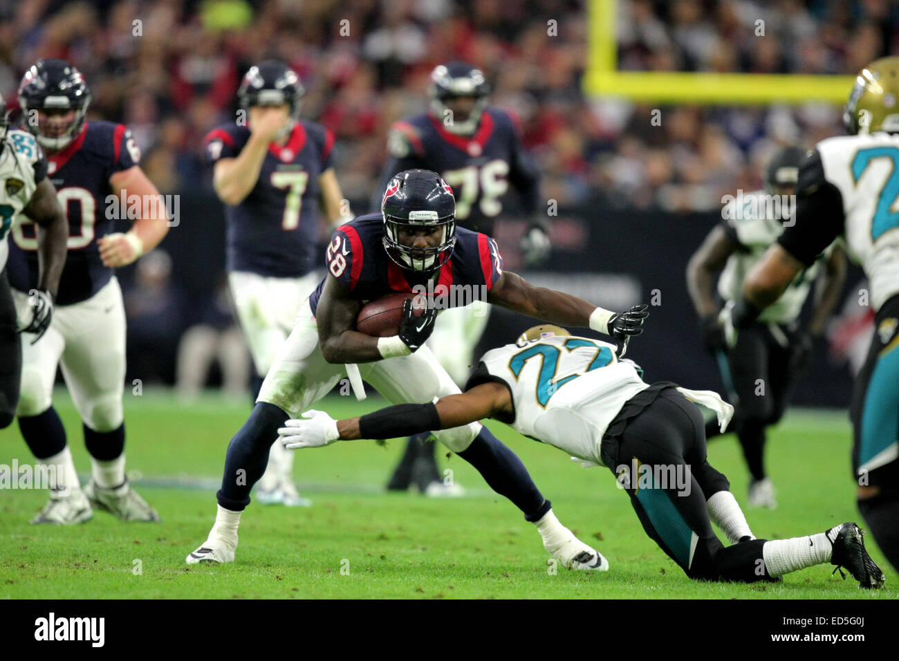 Houston, TX, USA. 28th Dec, 2014. Houston Texans running back Alfred Blue #28 looks to sidestep Jacksonville Jaguars - Stock Image