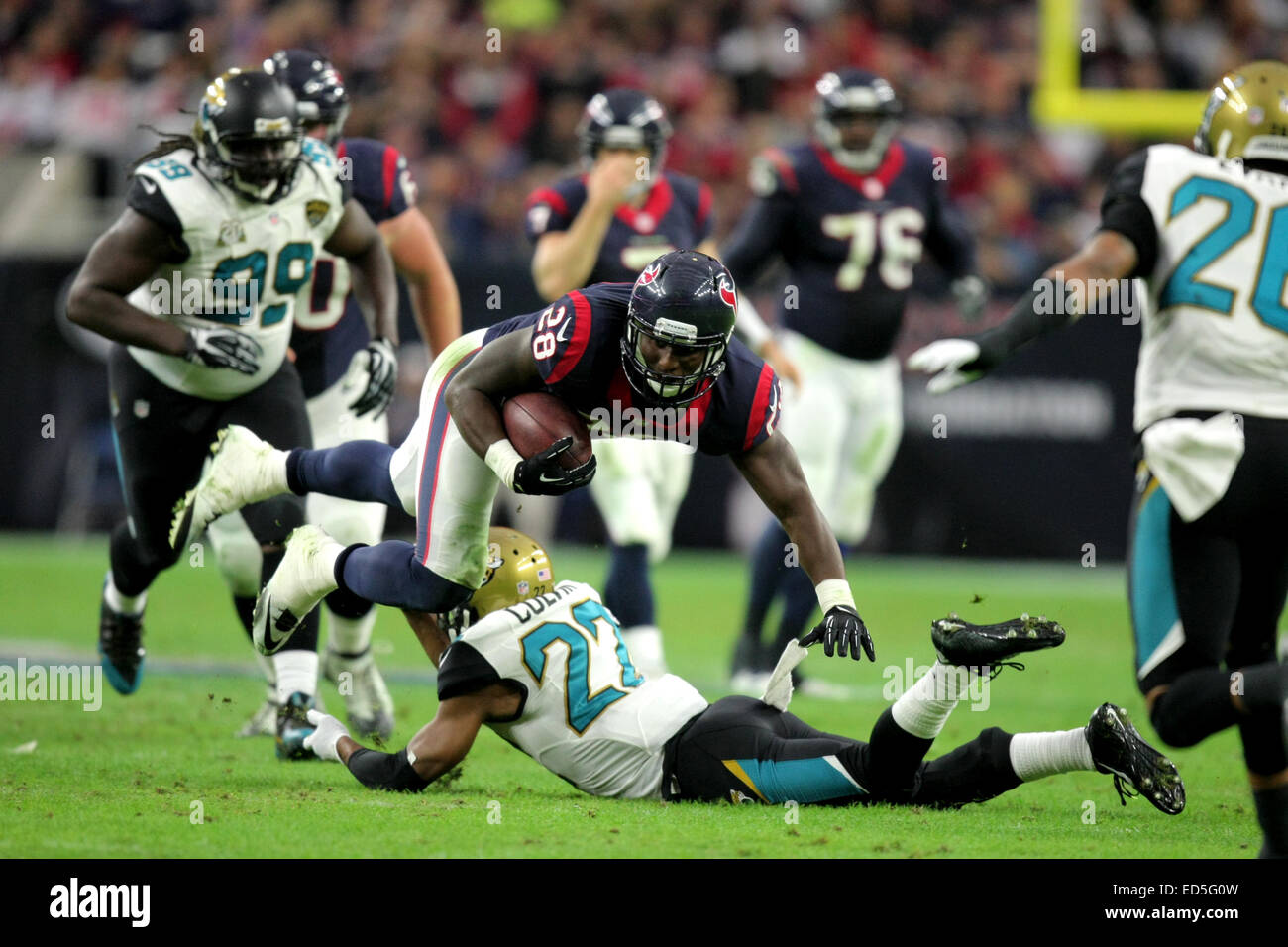 Houston, TX, USA. 28th Dec, 2014. Houston Texans running back Alfred Blue #28 is tripped up by Jacksonville Jaguars - Stock Image