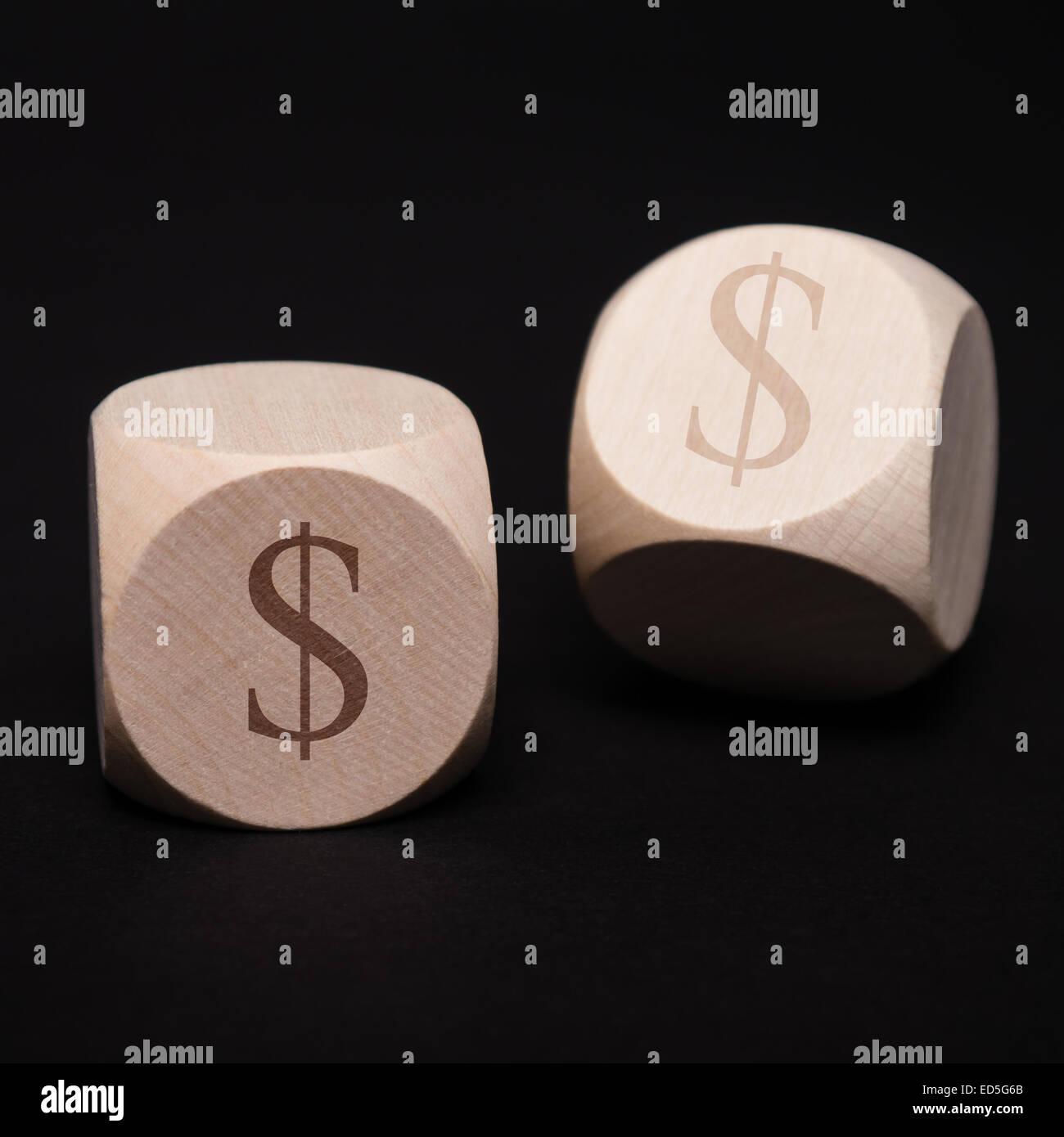 dice with dollar symbol on black background - Stock Image