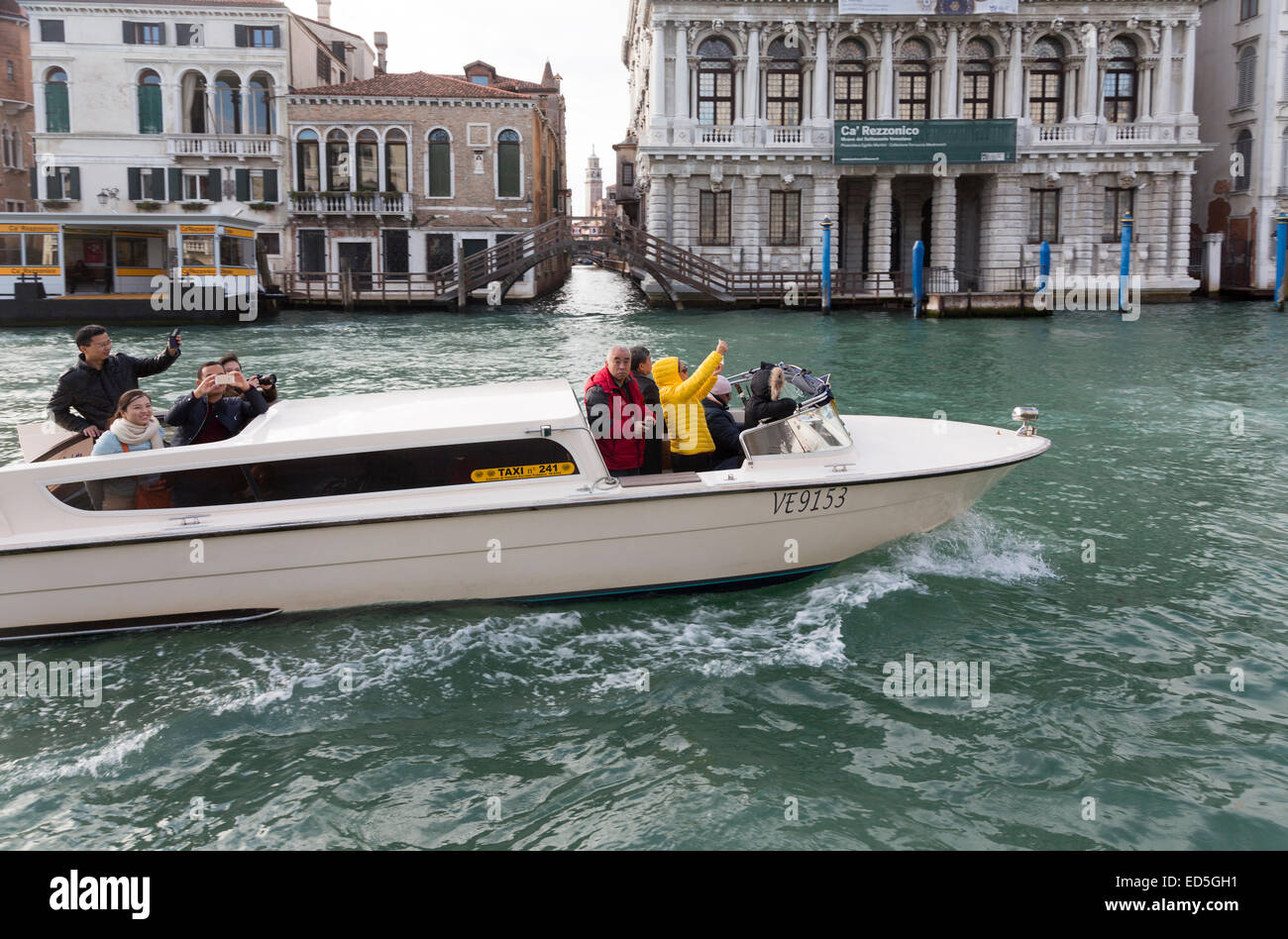 tourists photographing on Venice taxi, Grand Canal, Venice, Italy - Stock Image