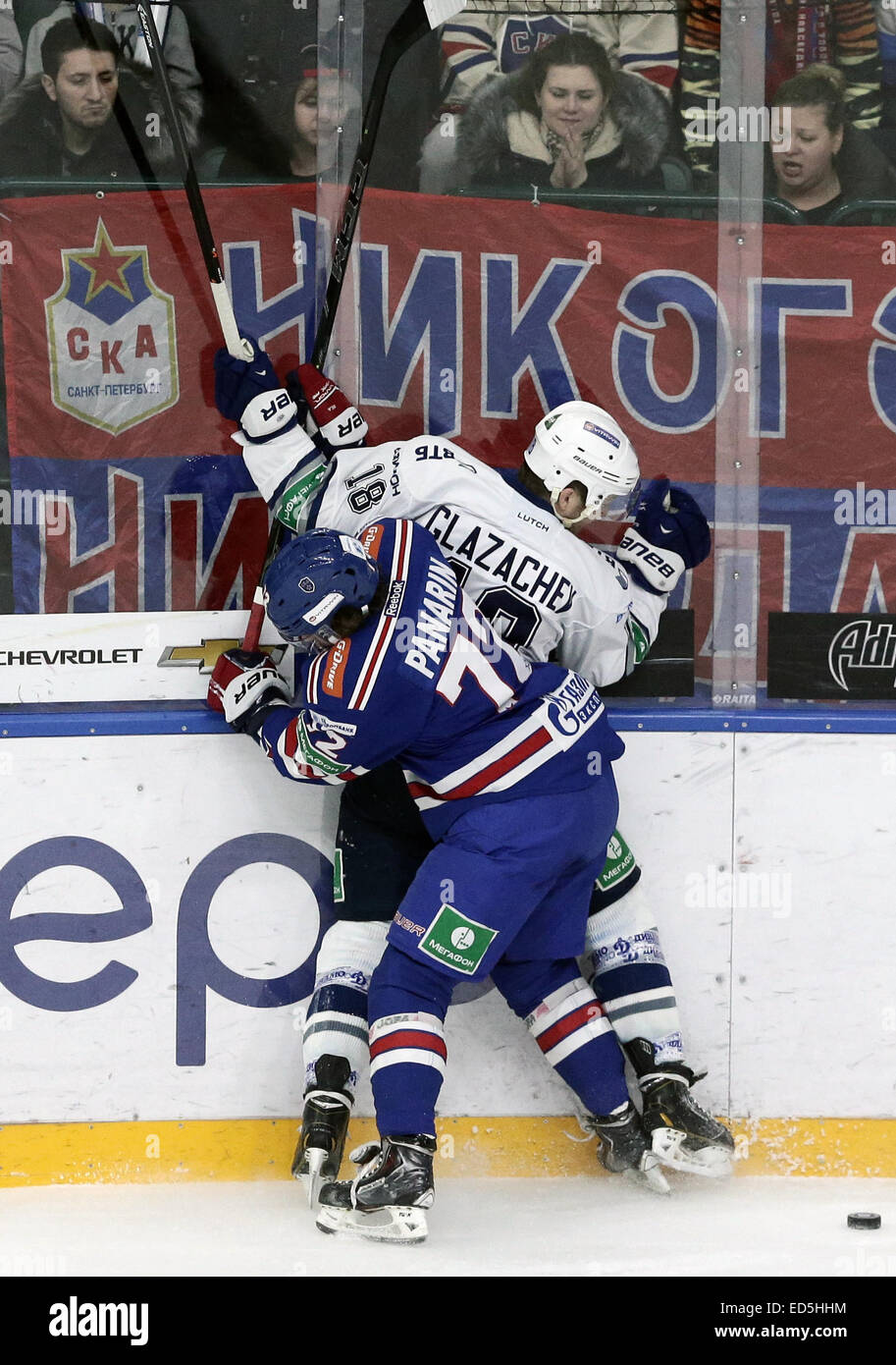 St. Petersburg, Russia. 28th Dec, 2014. SKA's Artemy Panarin (foreground) and Dynamo's Konstantin Glazachev and Stock Photo