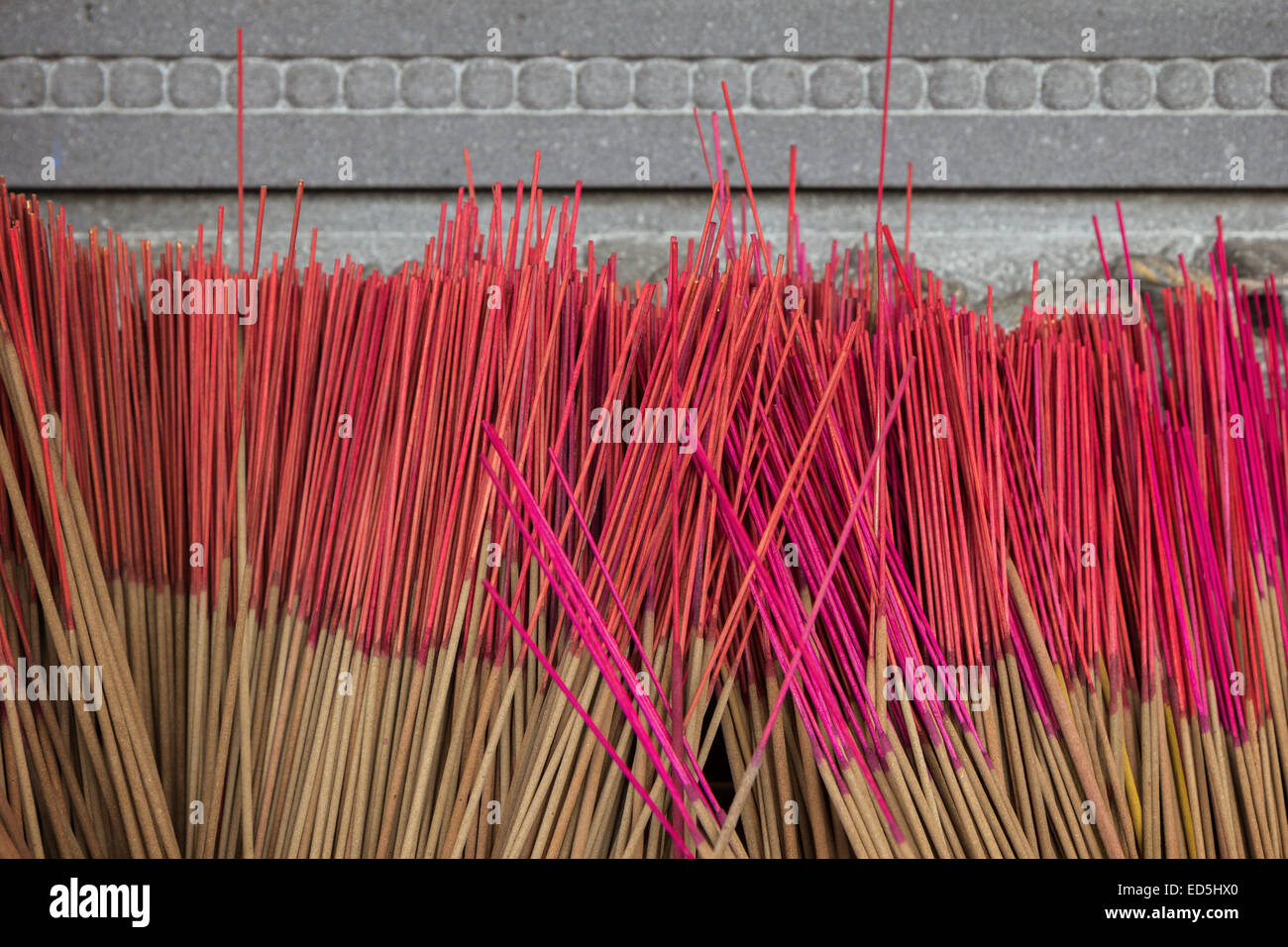 Closeup of group of unused incense sticks at a Buddhist temple in Taiwan - Stock Image