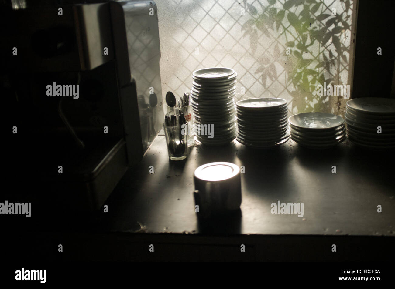 Saucers prepared at the counter of a bar. - Stock Image