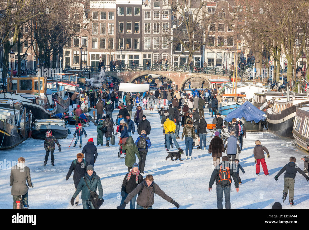 Amsterdam Ice Skating on a frozen Canal in winter. Keizersgracht and Brouwersgracht Canals - Stock Image