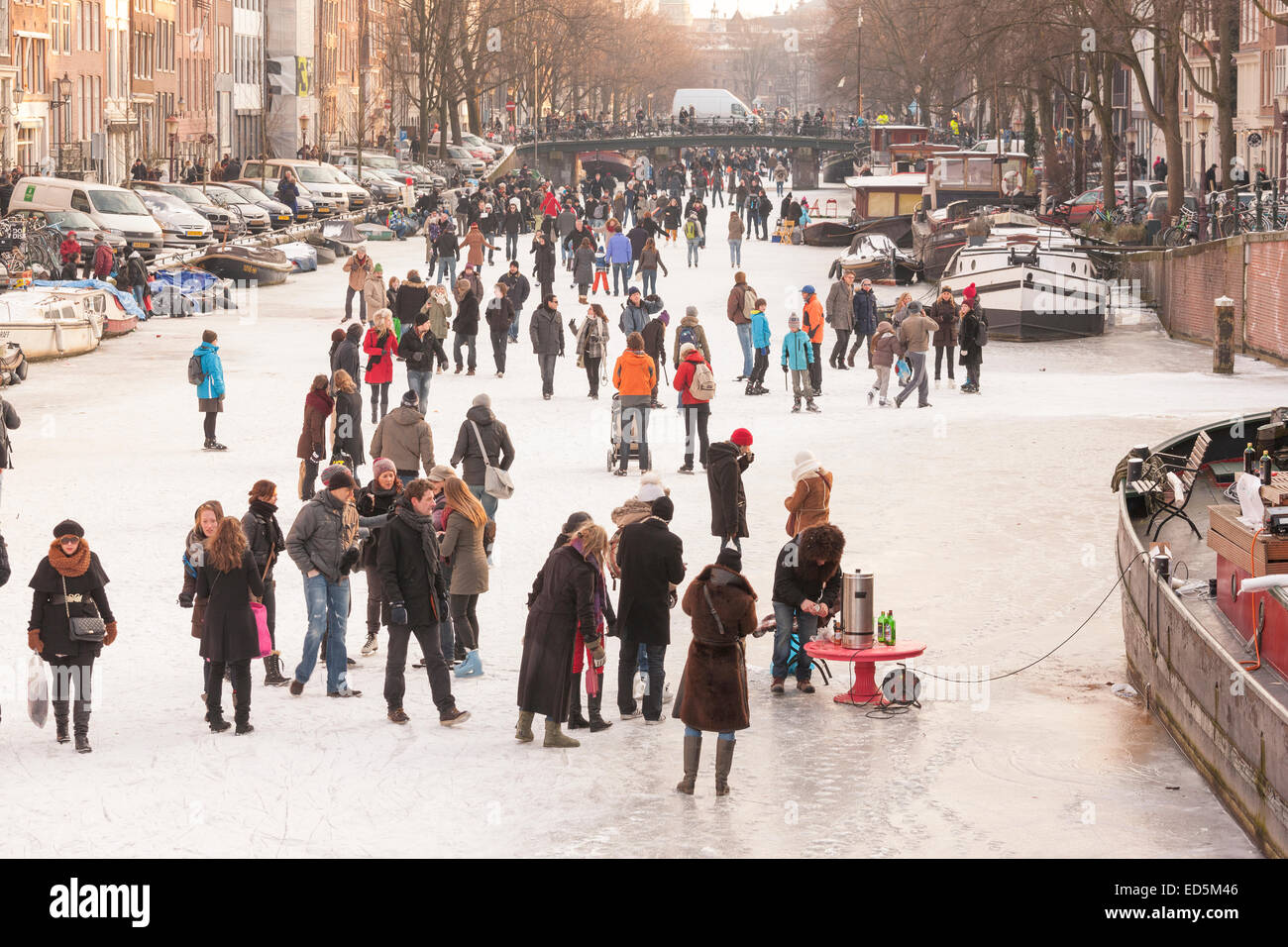Amsterdam Ice Skating on a frozen Canal in winter. Prinsengracht Canal. - Stock Image