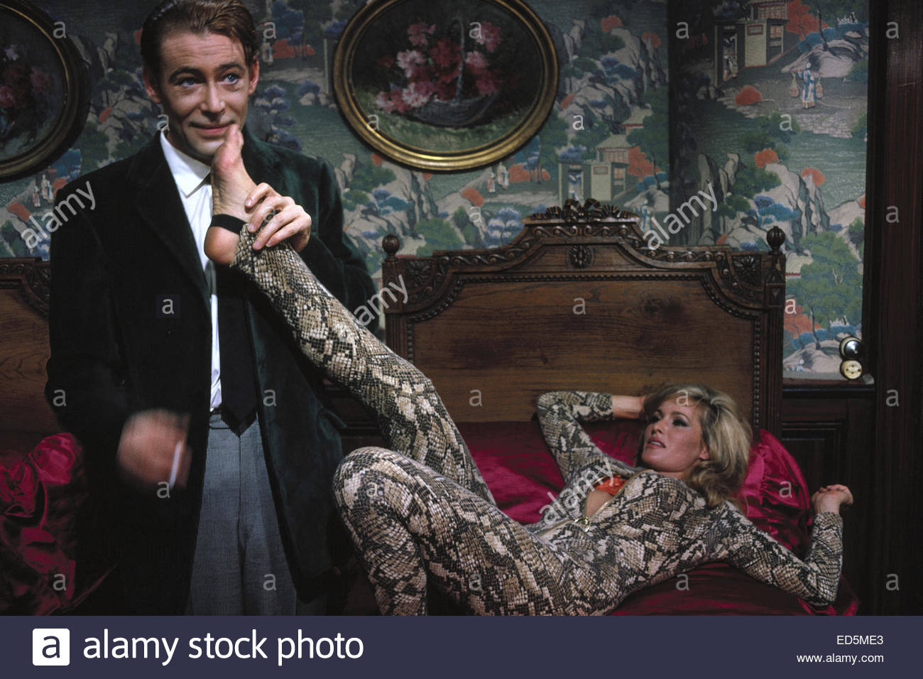 WHAT'S NEW PUSSYCAT (1965). Pictured:   Peter O'Toole & Ursula Andress. Courtesy Granamour Weems Collection. - Stock Image