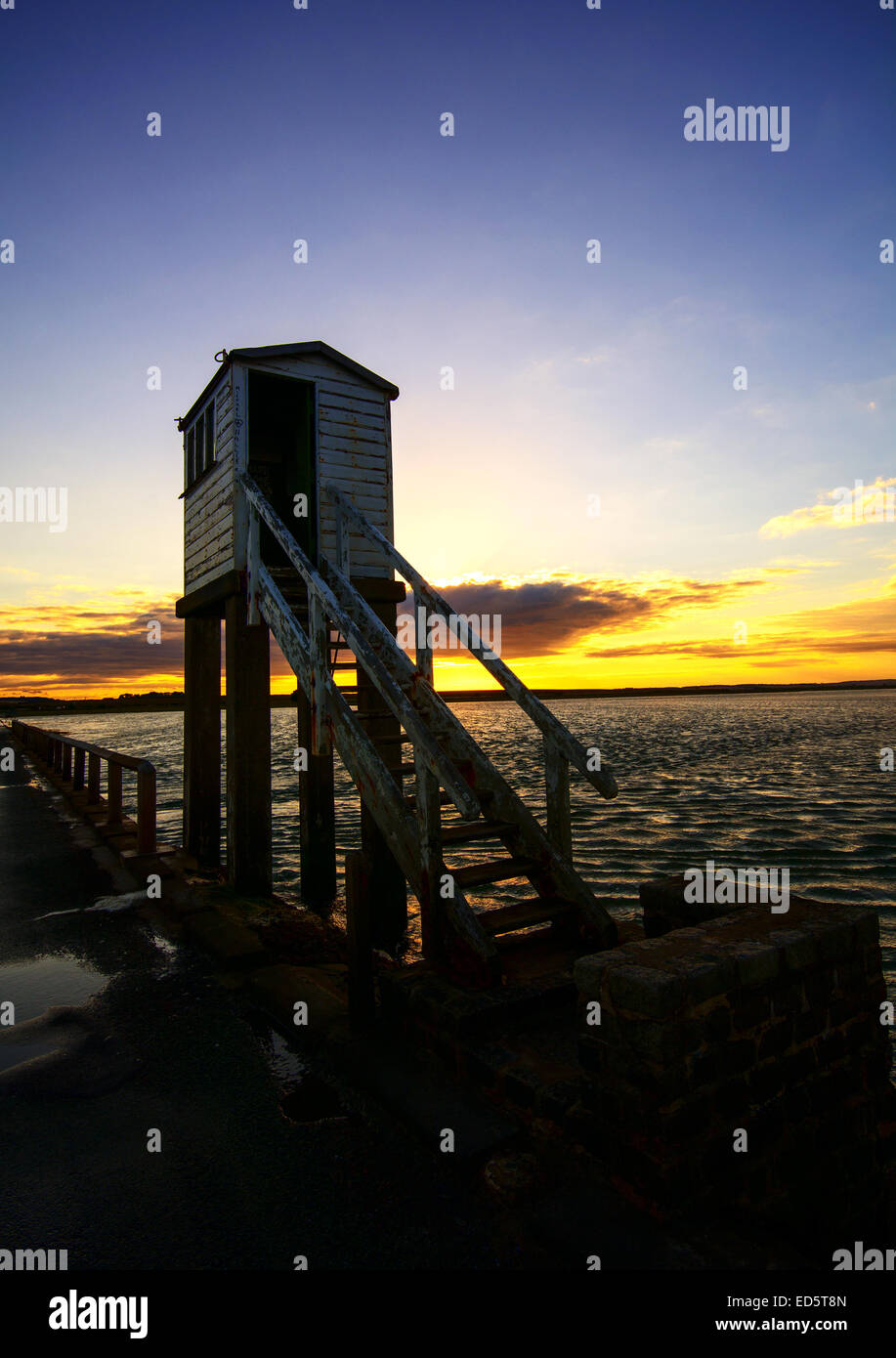 The causeway that crosses over to Lindisfarne (Holy Island) on the Northumberland coast at sunset. Northumberland Stock Photo