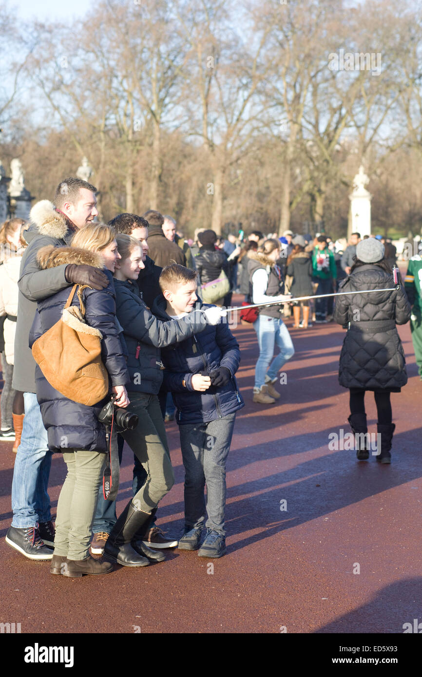 Families and Friends taking selfies outside Buckingham Palace London england - Stock Image