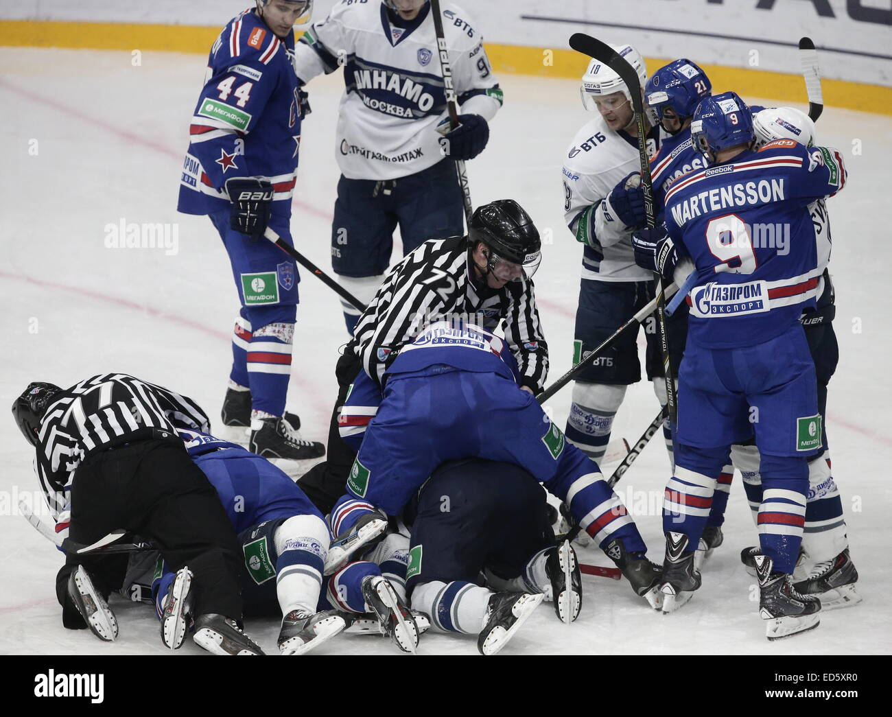 St. Petersburg, Russia. 28th Dec, 2014. SKA's and Dynamo's players fight in their 2014/2015 KHL Regular Season ice Stock Photo