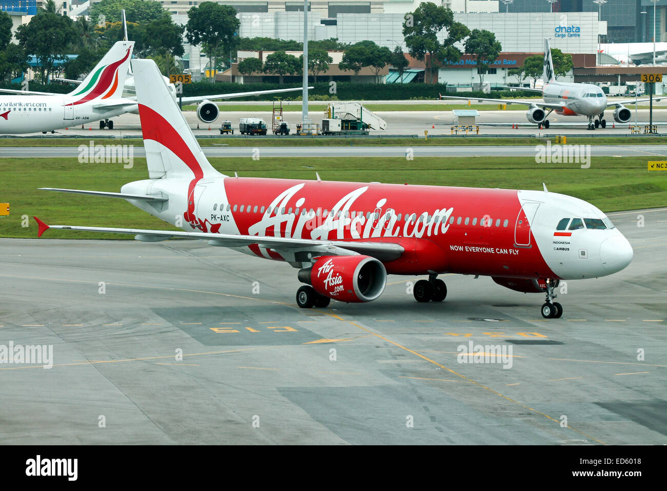 FILE PIC: Singapore Changi Airport, Singapore. 21st February, 2012. Indonesia AirAsia Airbus A320, registration Stock Photo