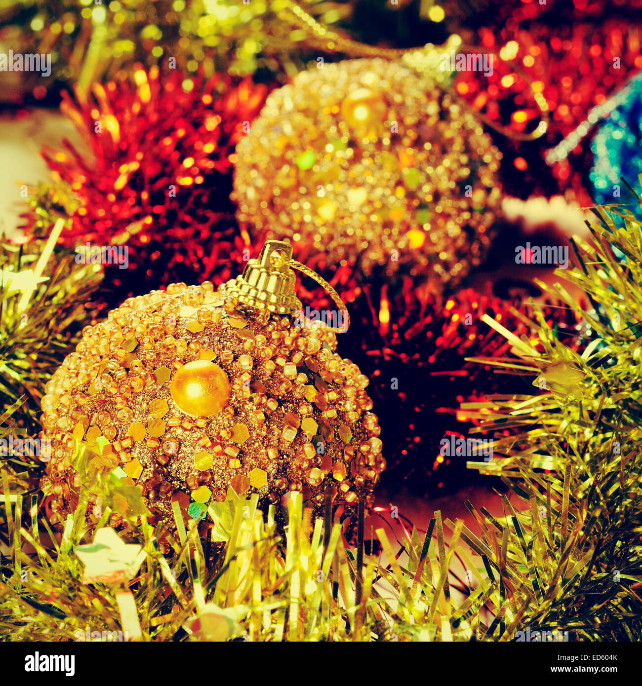 picture of some christmas balls and tinsel of different colors, with a retro effect - Stock Image