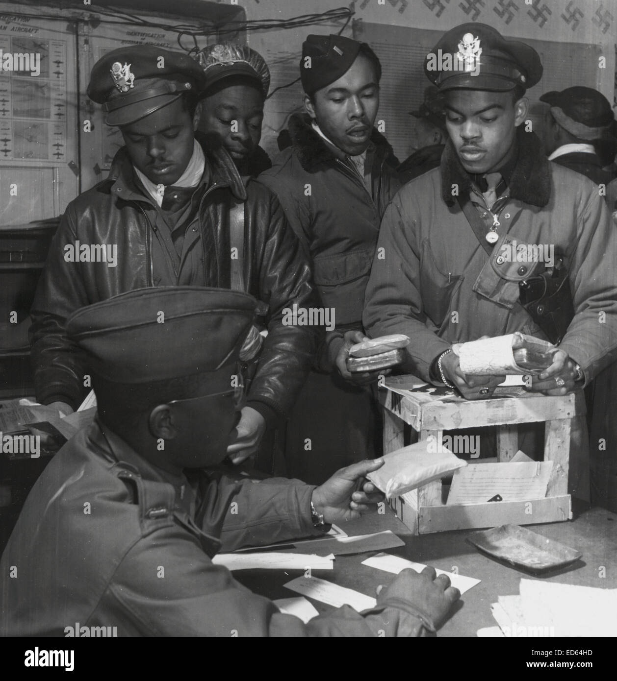 Tuskegee Airmen 332nd Fighter Group fighter pilots receive 'Escape kits' (cyanide)  in southern Italy, 1945 - Stock Image