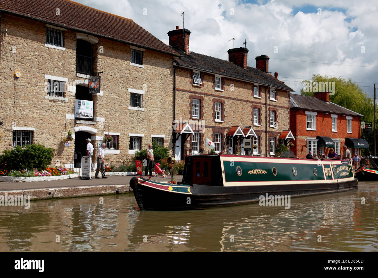 A narrowboat on the Grand Union Canal in Northamptonshire outside the Stoke Bruerne Canal Museum - Stock Image