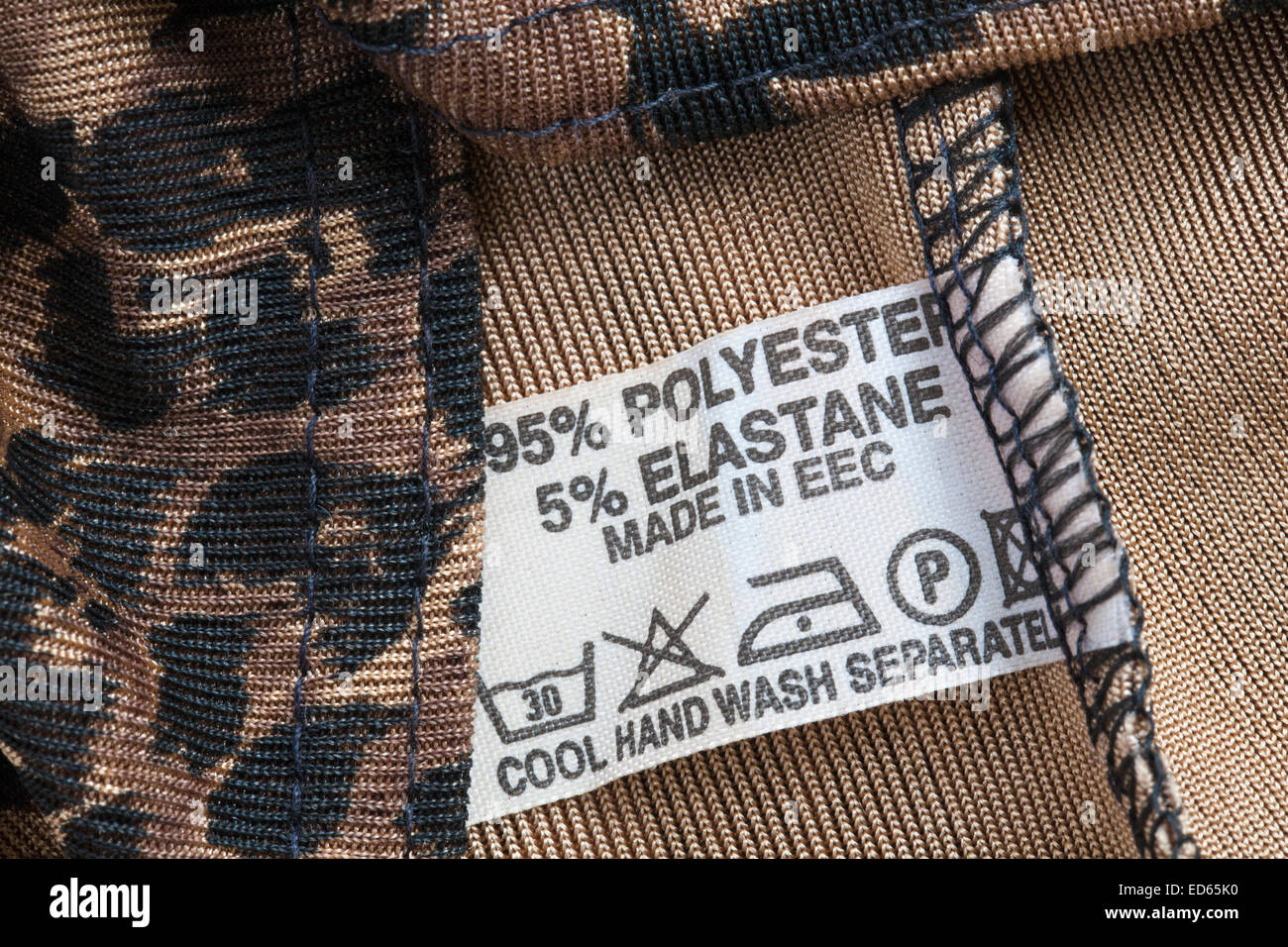 65% polyester 5% elastane made in EEC label in garment - Stock Image