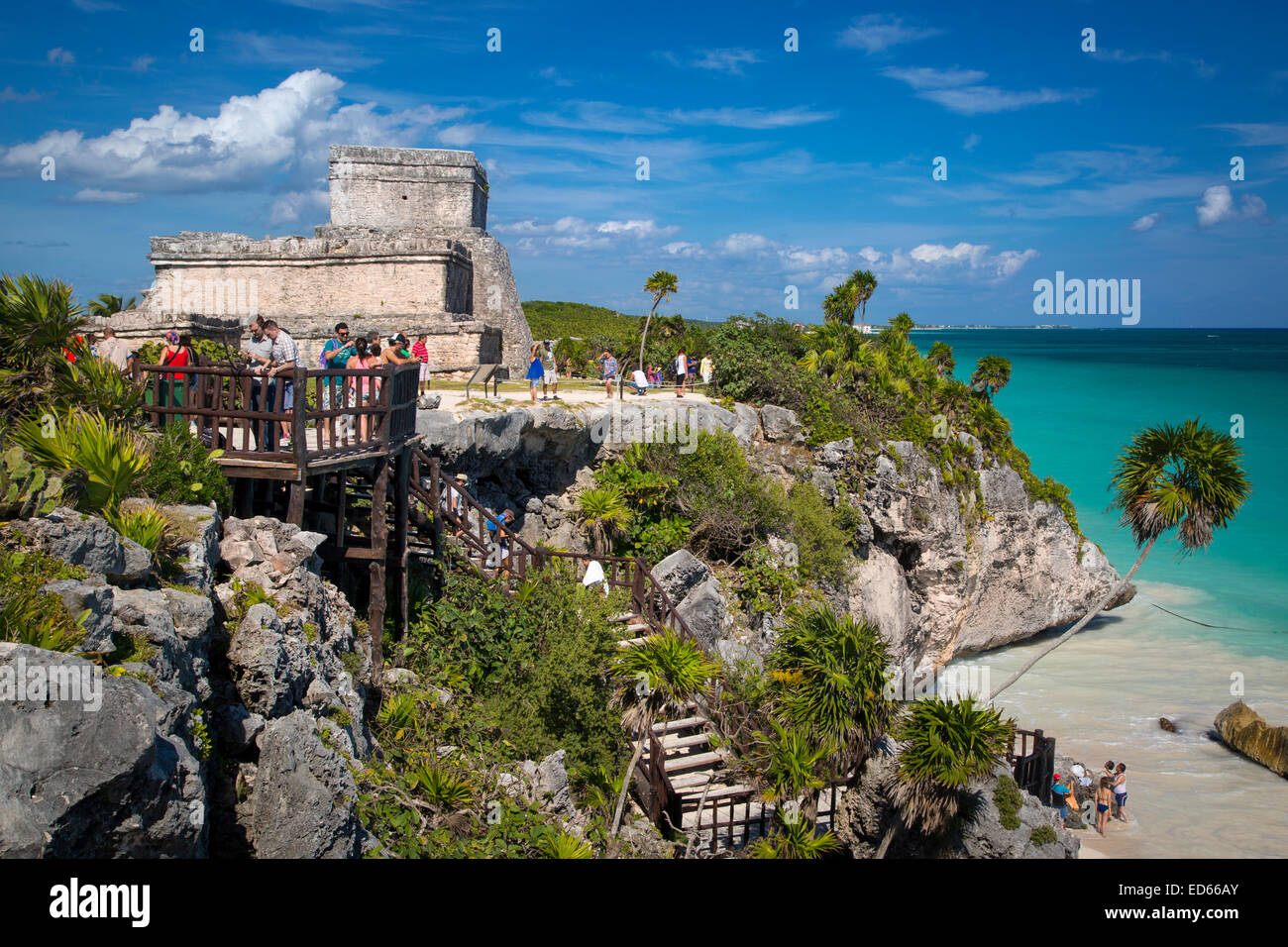 Tourists visiting ruins of the Mayan temple grounds at Tulum, Quintana Roo, Yucatan, Mexico - Stock Image