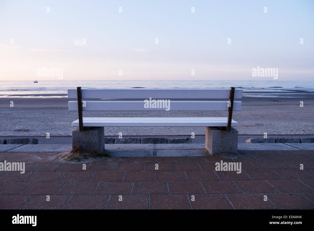 bench at the beach in evening (norderney) Stock Photo