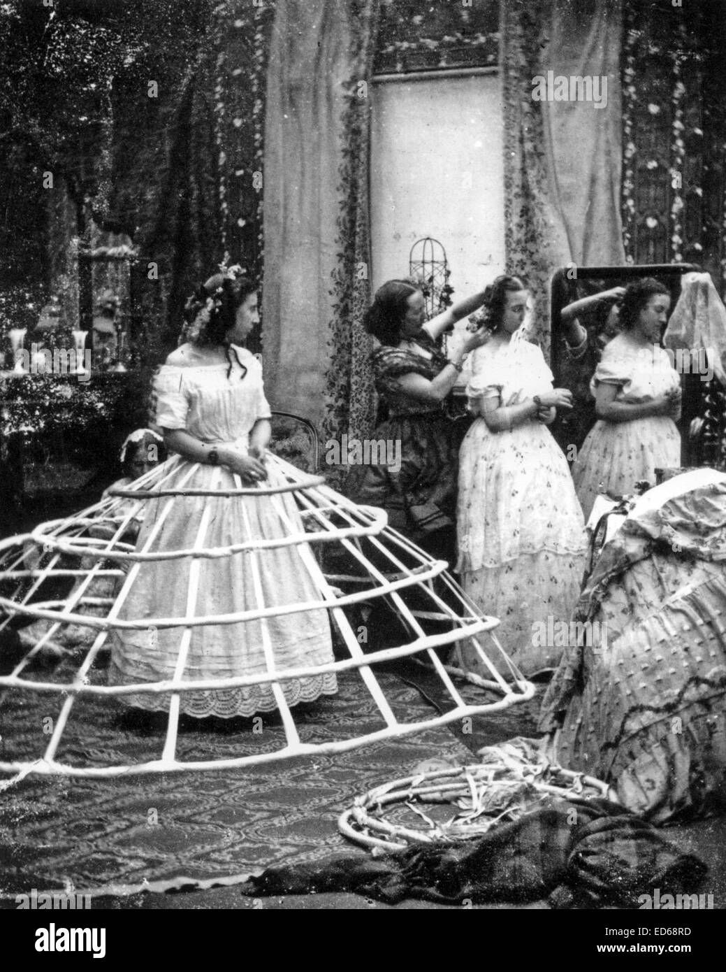 cf688433ee4 HOOPED SKIRT (aka Cage Crinoline) Part of a comic French series of photos  about 1860 showing the stages of putting on a crinoline skirt supported by  a cage