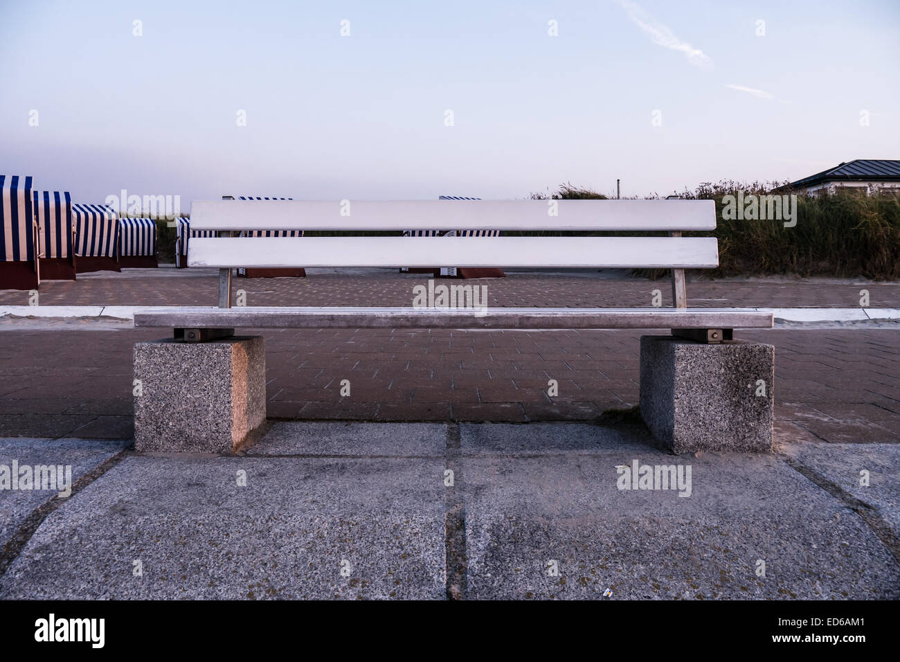 bench on norderney, in background beach chairs Stock Photo