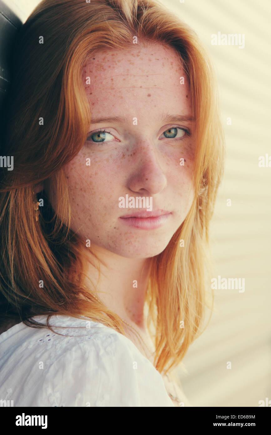 Closeup portrait of beautiful young redhead girl - Stock Image