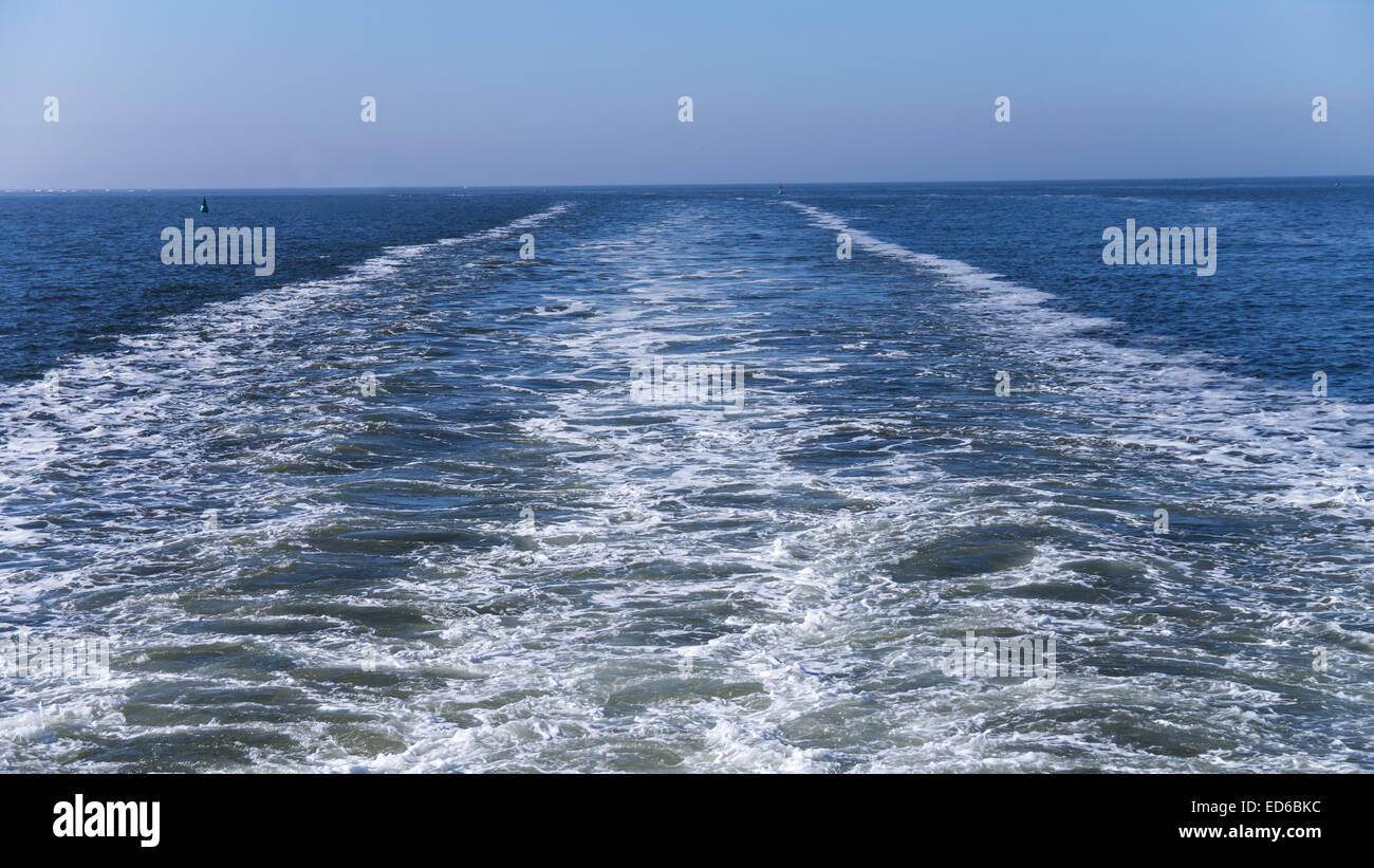 foamy track behind ship on north sea Stock Photo