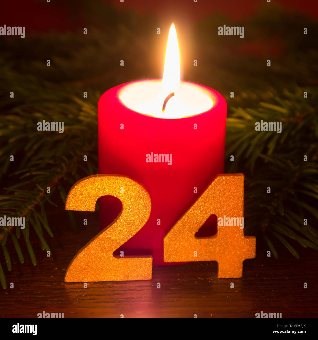 24 december, red candle - Stock Image