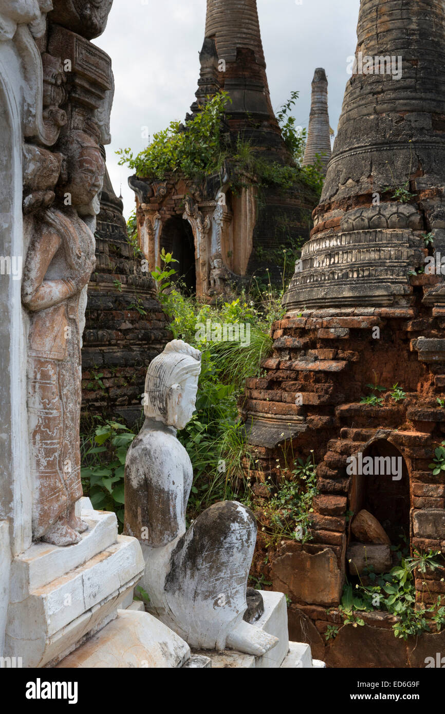 12th C stupas and statue, Inthein ruins near Inle Lake, Myanmar - Stock Image
