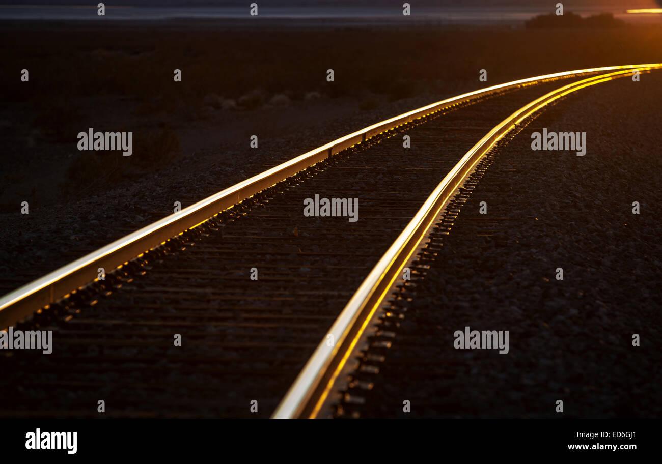 Sunset on the railway tracks in the California desert. - Stock Image