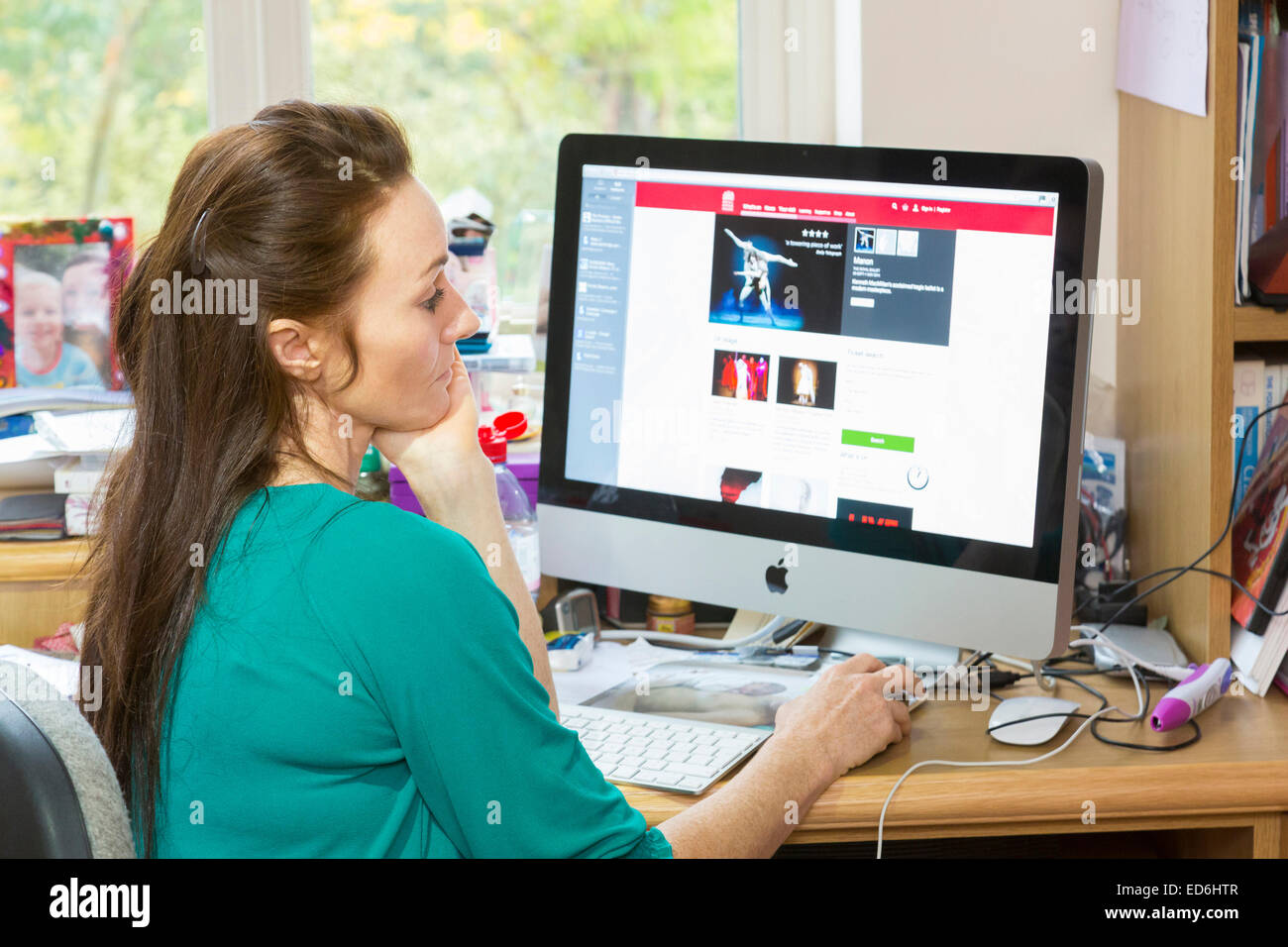woman working in her home office - Stock Image