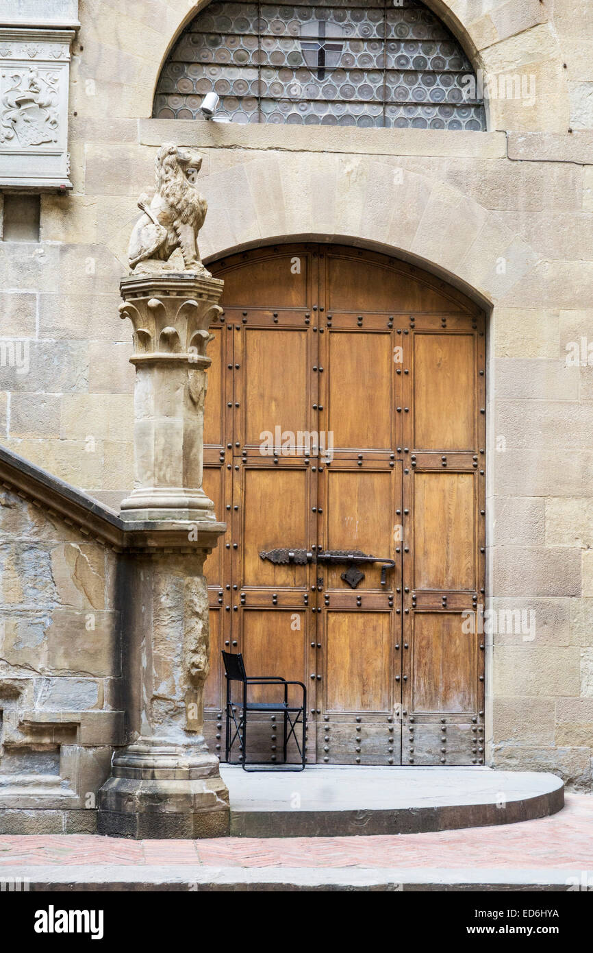 beautiful sturdy old wooden door to courtyard of Bargello museum the oldest public building in Florence formerly - Stock Image