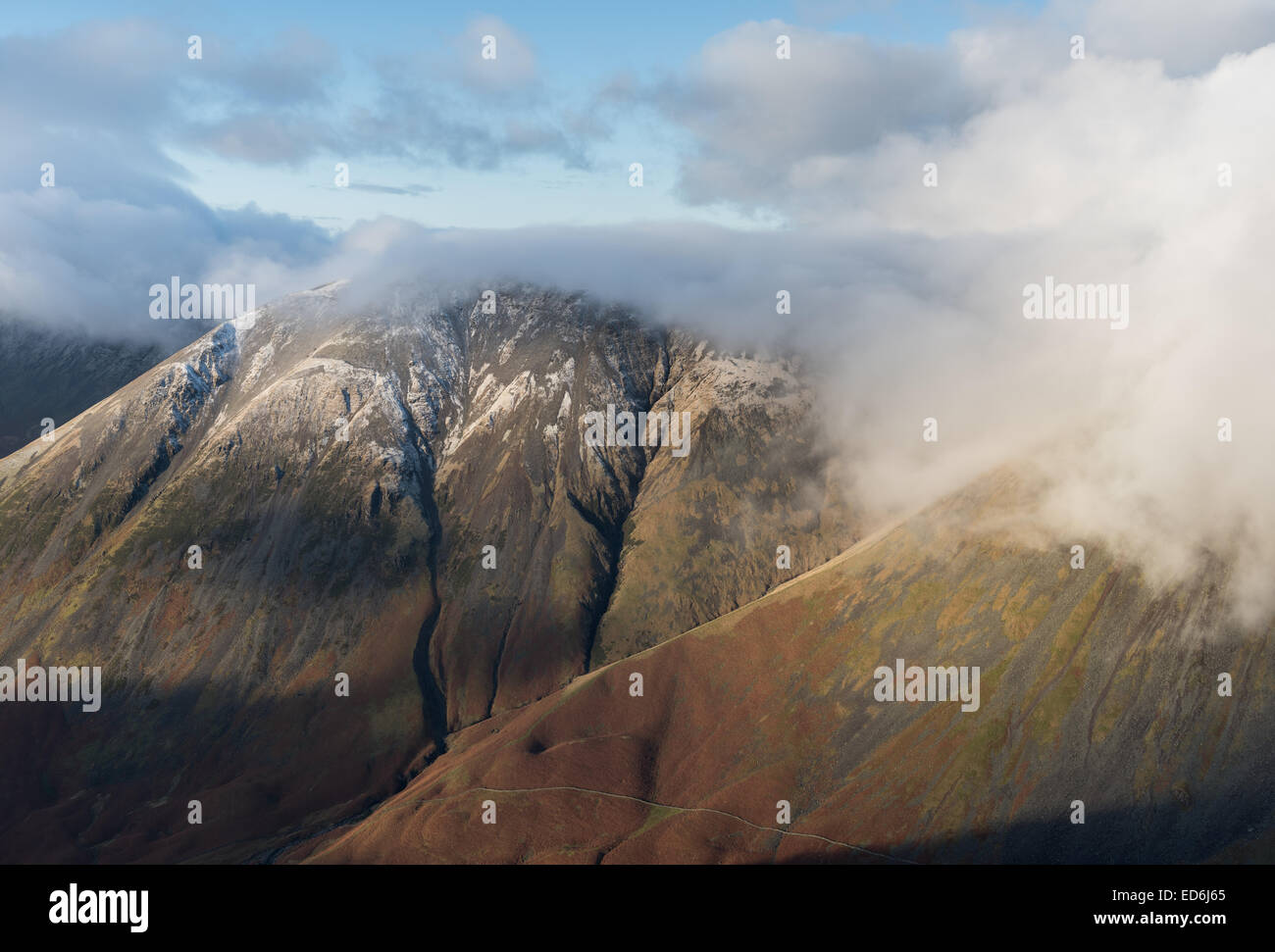 Snow dusted Kirk Fell and Great Gable, mountains in the English Lake District - Stock Image