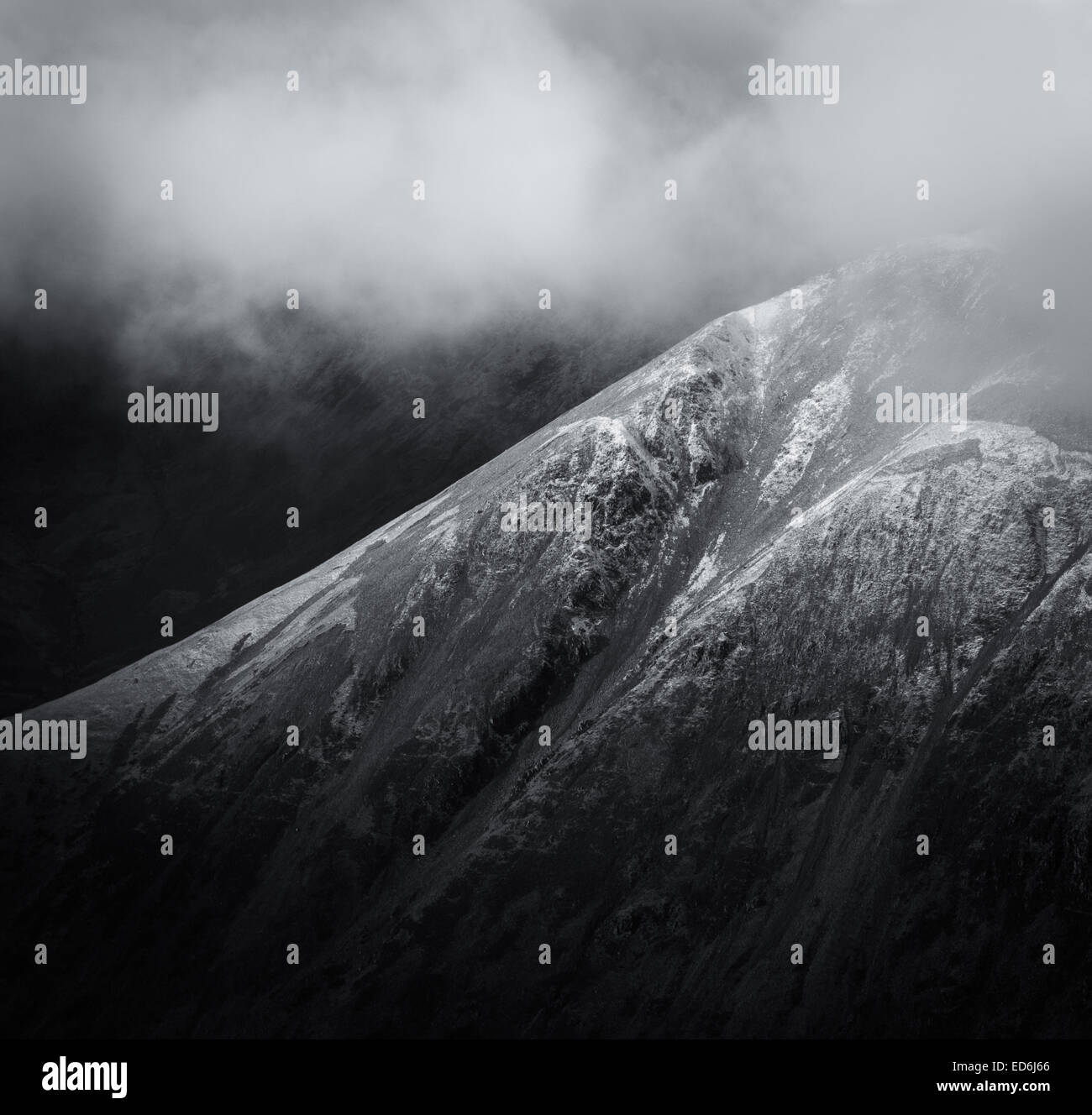 Close up black and white of snow dusted Kirk Fell in the English Lake District - Stock Image