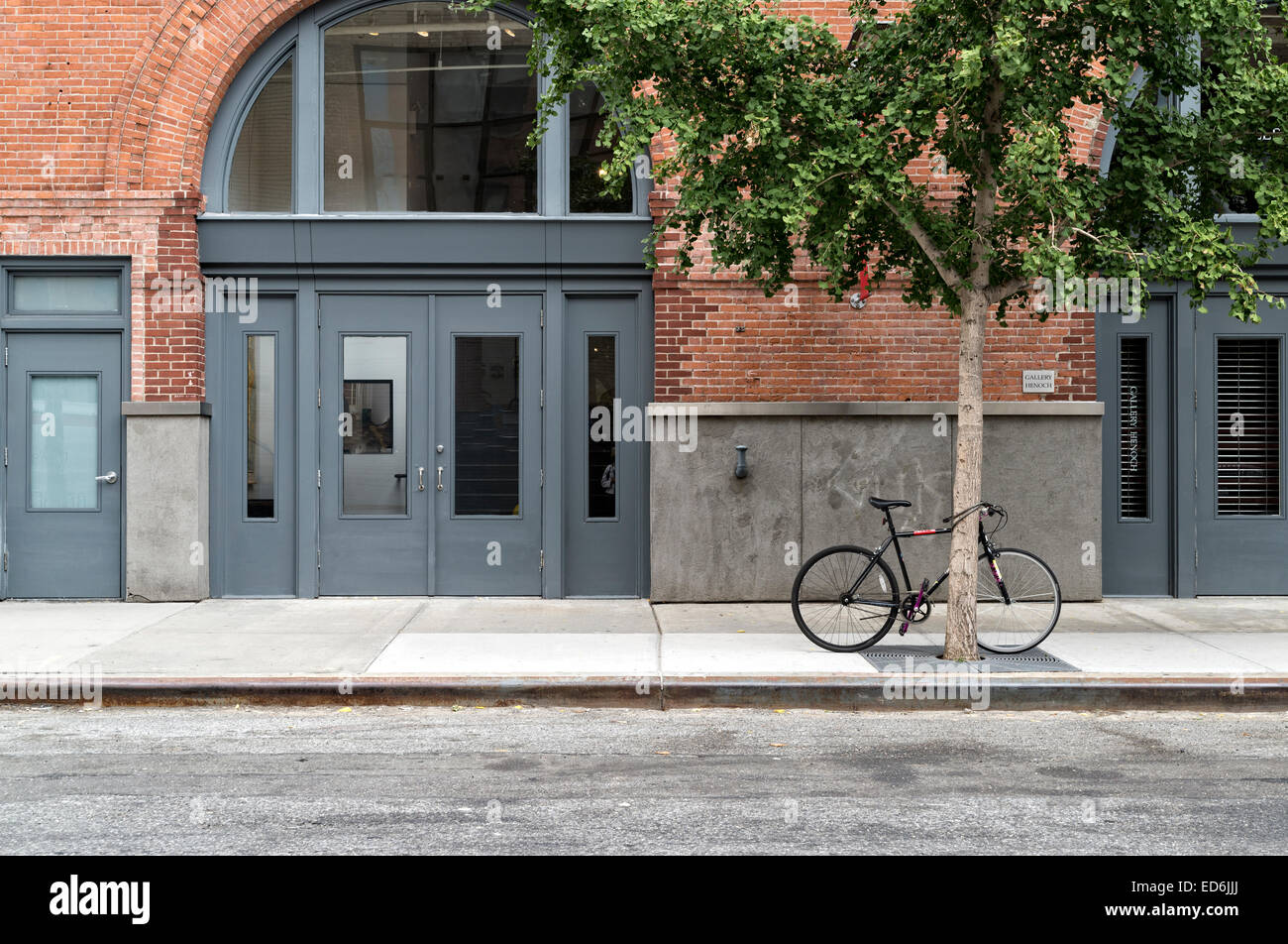 Arched Double Entry Doors And Front Facade, In The Chelsea Art Gallery  District Of Manhattan, New York City, Bike Chained To A T