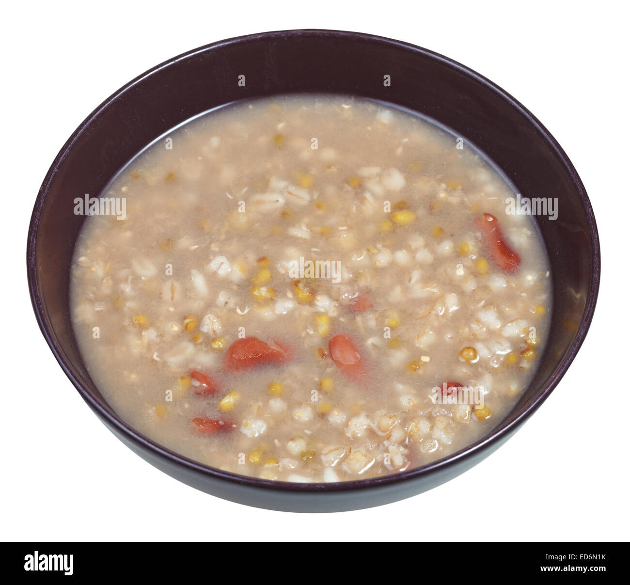 rustic bean soup in bowl isolated on white background - Stock Image
