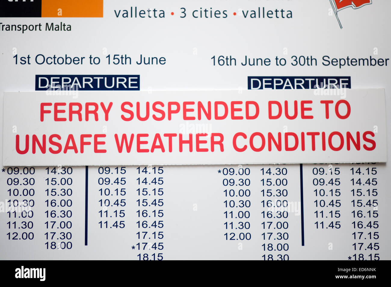 Sign warning of the cancellation of the Gozo ferry due to weather conditions Stock Photo
