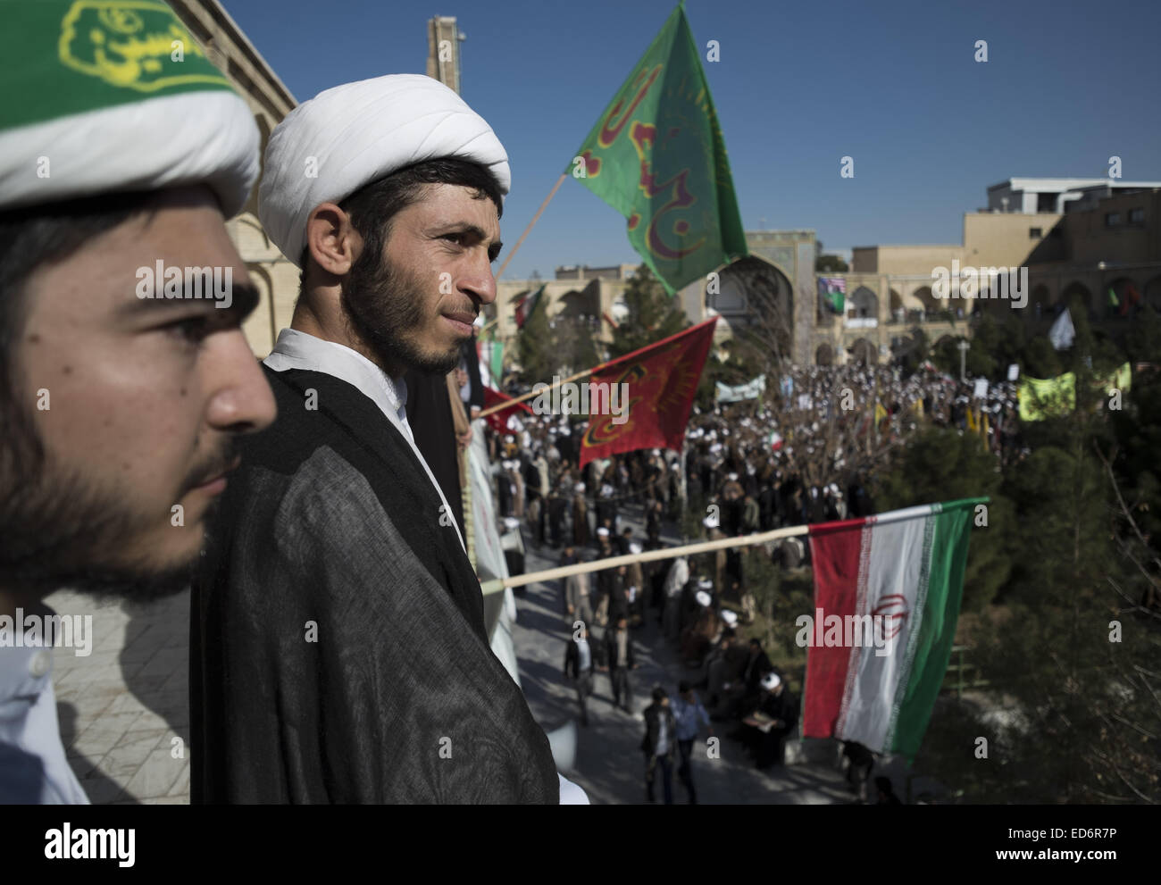 Qom, Iran. 29th Dec, 2014. December 30, 2014 - Qom, Iran - Two Iranian clerics look on while attending a rally to - Stock Image