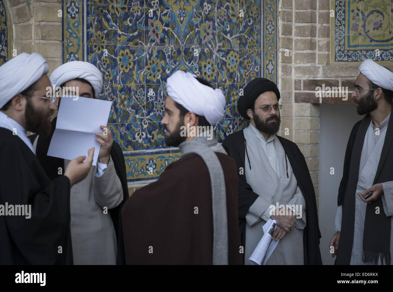 Qom, Iran. 30th Dec, 2014. Iranian clerics talk with each other during a rally to mark December 30, 2009 demonstration - Stock Image