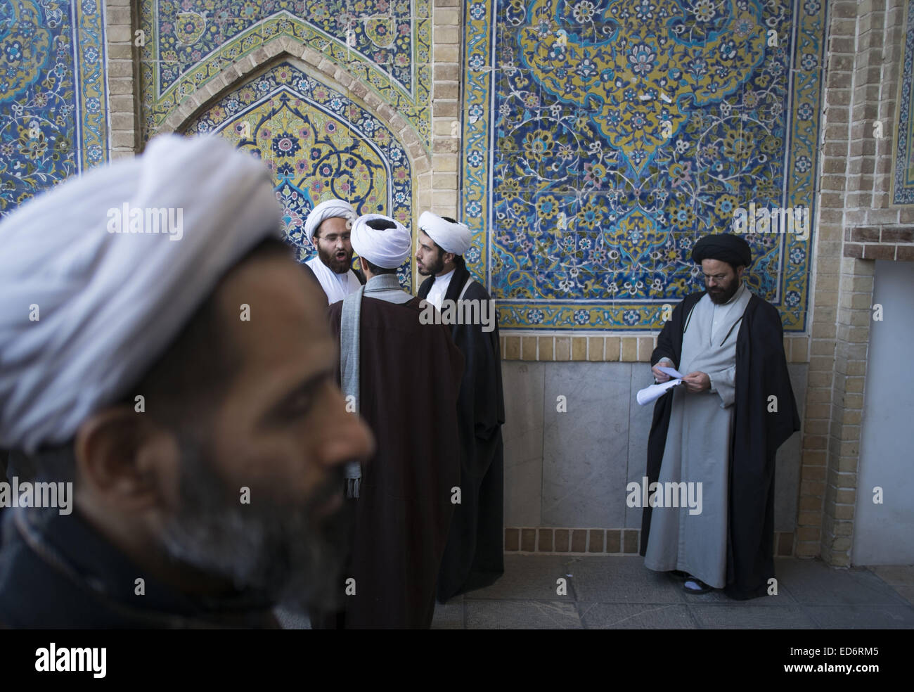 Qom, Iran. 29th Dec, 2014. Iranian clerics talk with each other during a rally to mark December 30, 2009 demonstration - Stock Image