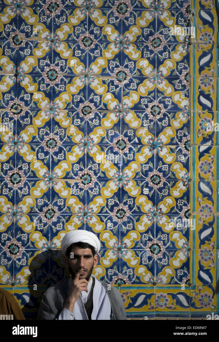 Qom, Iran. 30th Dec, 2014. An Iranian cleric looks on while attending a rally to mark December 30, 2009 demonstration - Stock Image