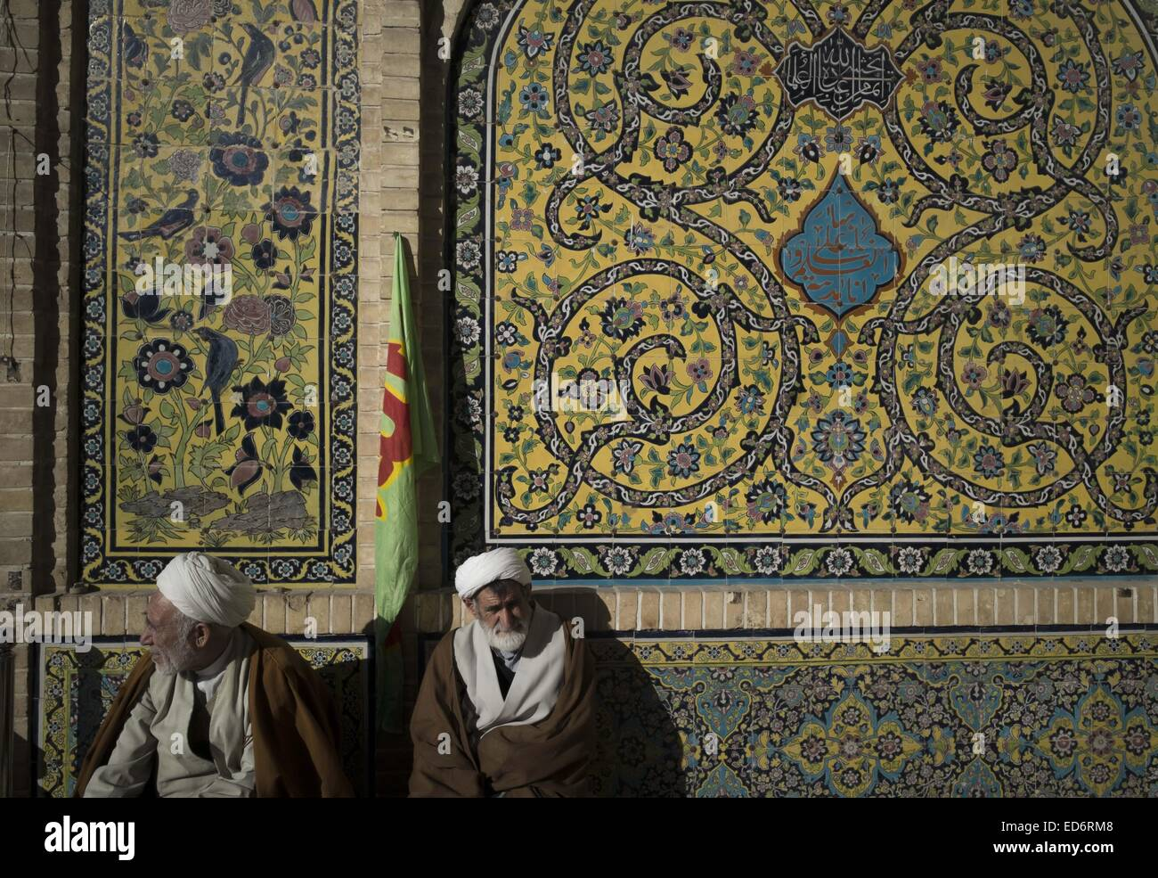 Qom, Iran. 29th Dec, 2014. Two Iranian clerics wait for the beginning of a rally to mark December 30, 2009 demonstration - Stock Image