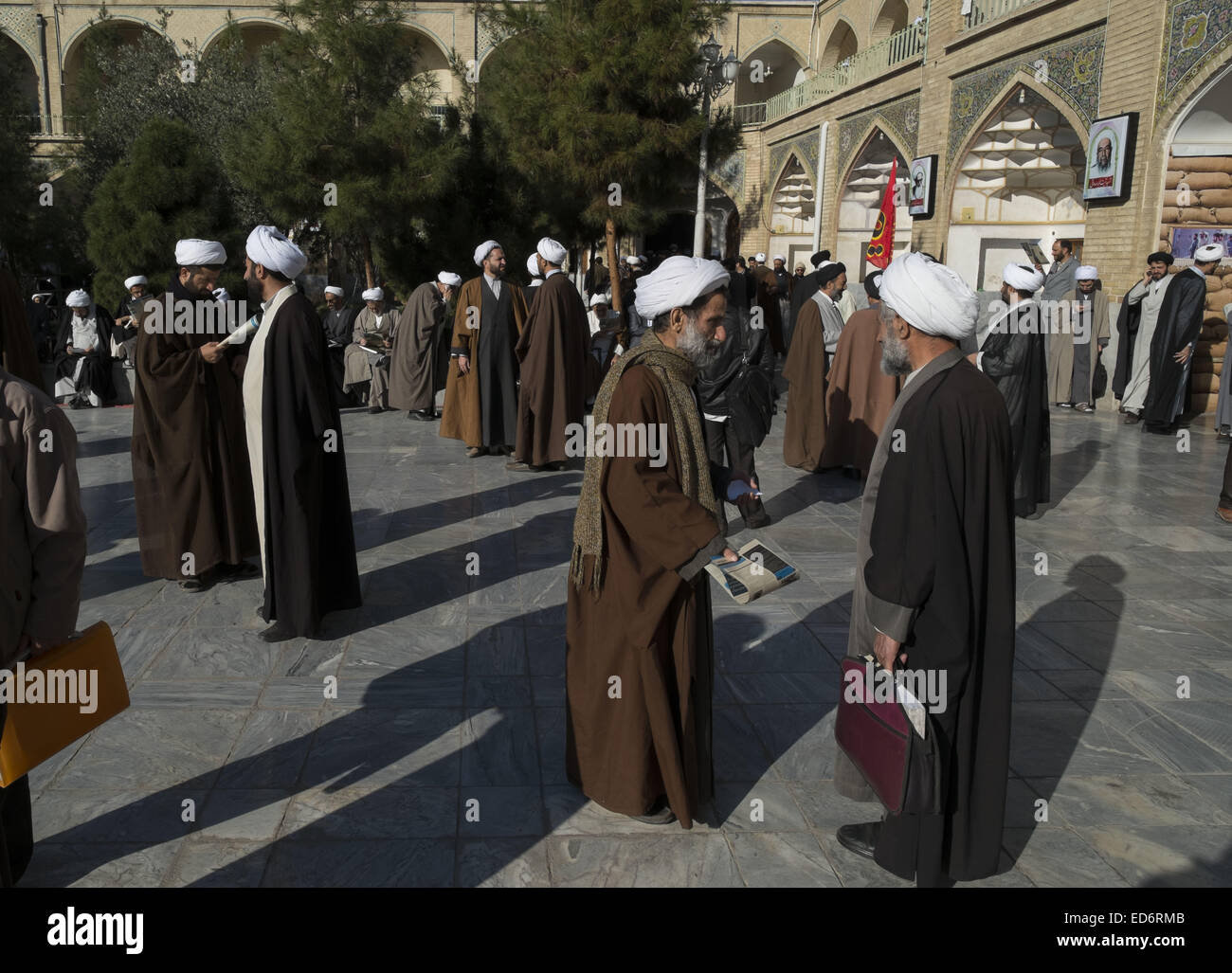 Qom, Iran. 29th Dec, 2014. Iranian clerics talk with each other before a rally to mark December 30, 2009 demonstration - Stock Image