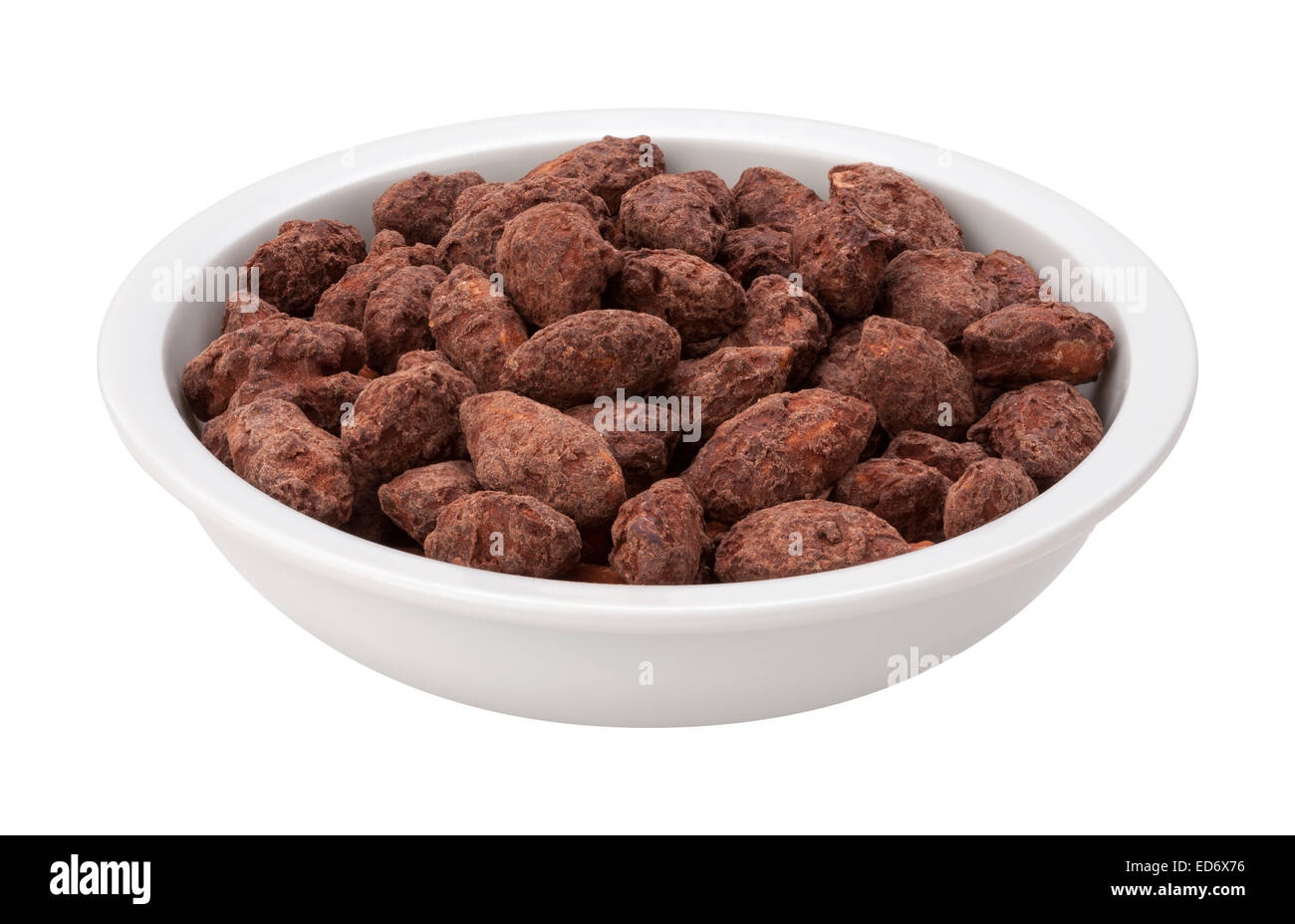 Chocolate Coated Almonds in a bowl - Stock Image
