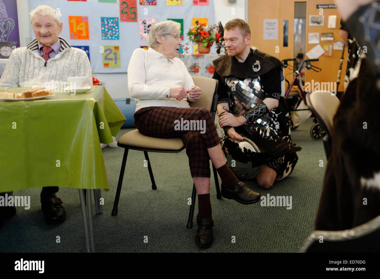 Edinburgh, UK. 30th December, 2014.  Up Helly Aa Vikings visit veterans charity Erskine Edinburgh Home  to sing Stock Photo