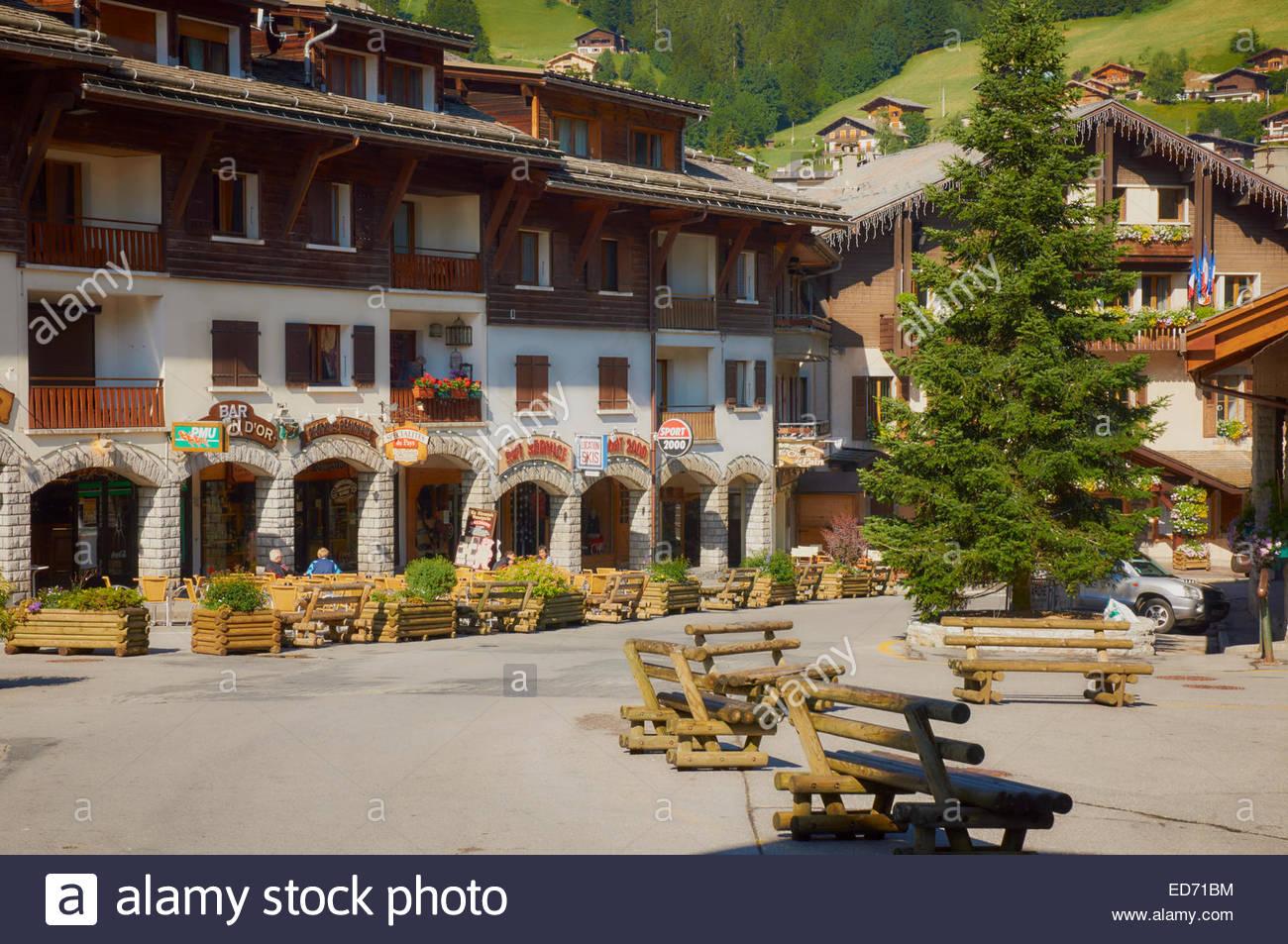 ski hire shops hotels cafe bistro place de l'eglis in french village of la clusaz france - Stock Image